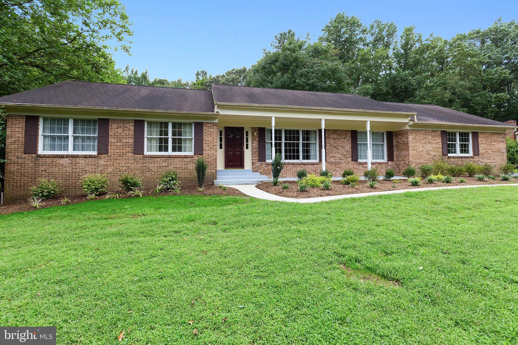 Quiet, one-level country living on 1.75 beautifully landscaped acres w/wide variety of flowering tre