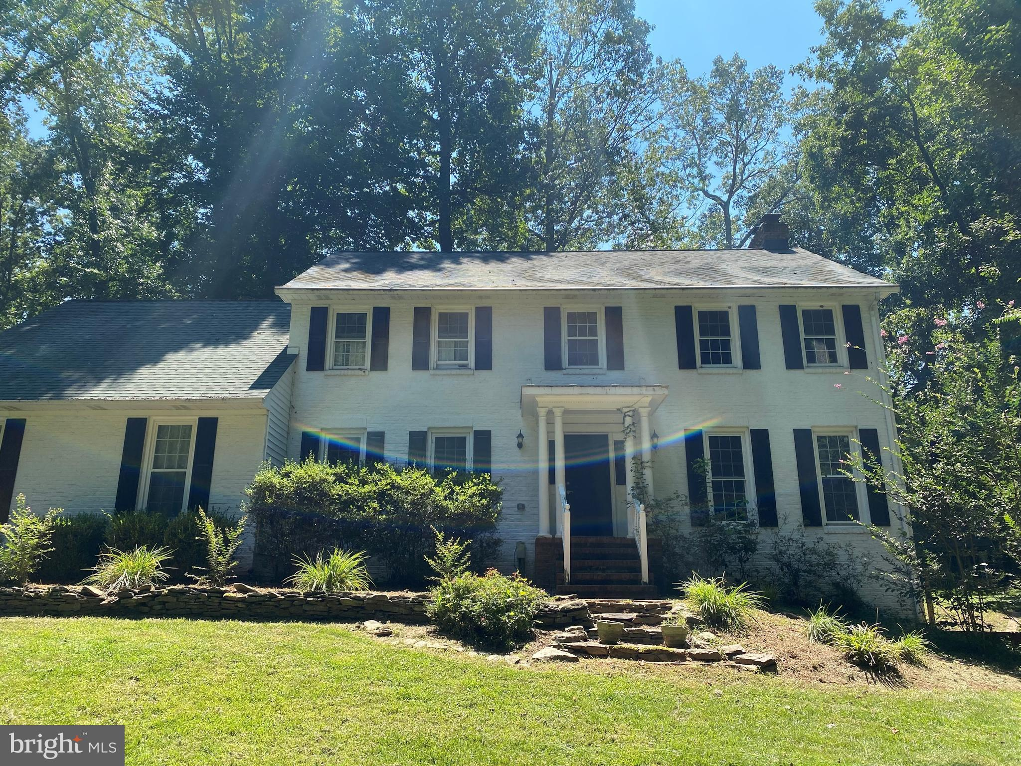 This gorgeous 4 bedroom 3 bath home is nestled on a large private lot in Warrenton, Virginia.  Highly sought after schools, mature trees, gardens, and outdoor spaces galore. The right person can easily turn this lovely home into their own personal palace on the hill!  Come see before it is gone! This stately, brick home has everything, even a Potting Shed with electric for those with a green thumb.
