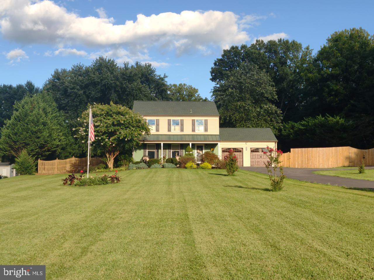 PEACEFUL LIVING in this 4 BR, 2.5 Bath Colonial on 1.46 acres. NEW Roof, NEW Gutters, NEW HVAC, NEW