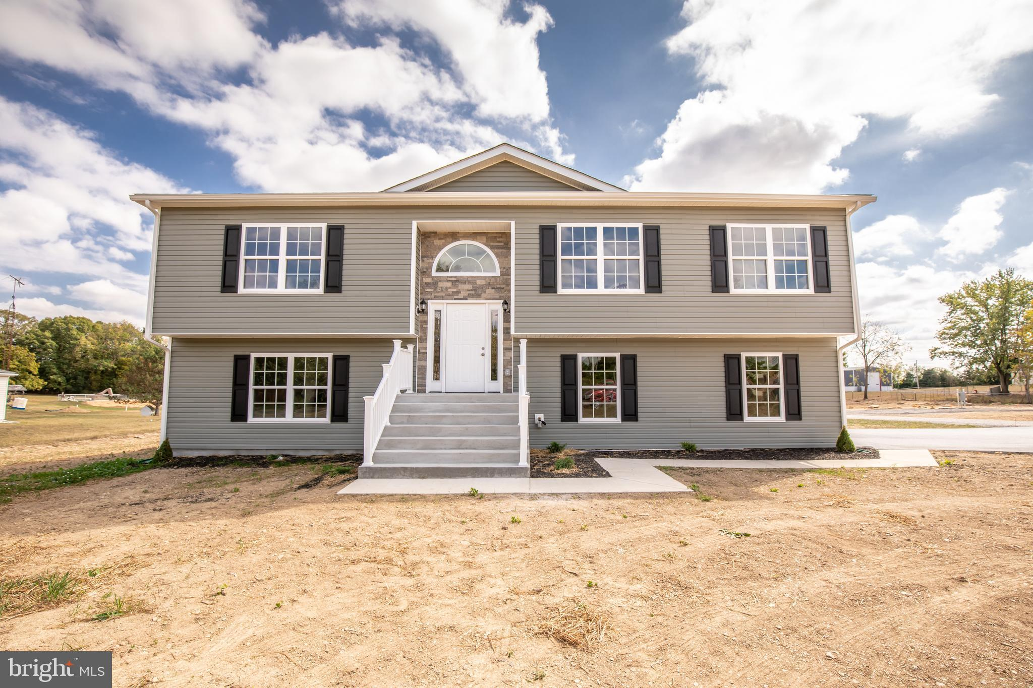 To Be Built.  Photos are of similar construction This split level home offers an open floorplan. The
