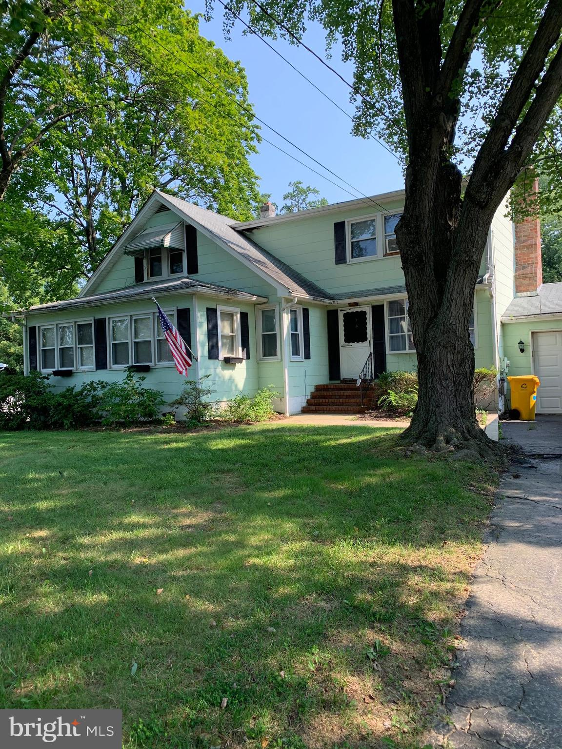 This versatile property is situated on two lots that are in the process of being divided into two separate addresses.  Great for home business, builder or family.  The house on the property is liveable but does need repairs.  Come make it your own!