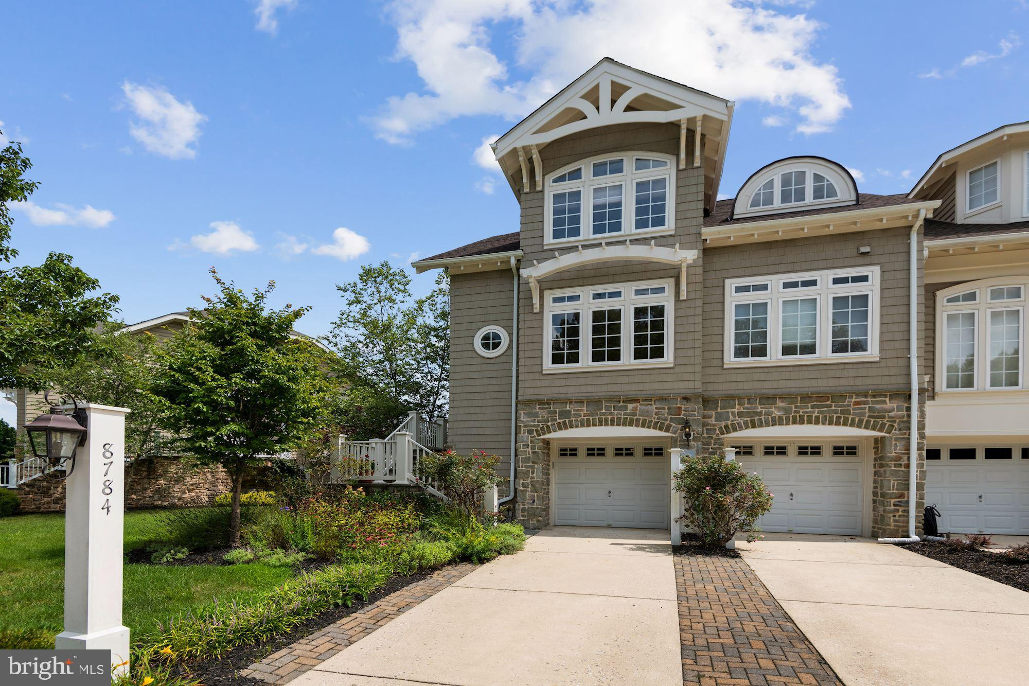 Come home to this stylish & bright lakefront 4 bedroom, 3.5 bath end-unit townhouse with year round