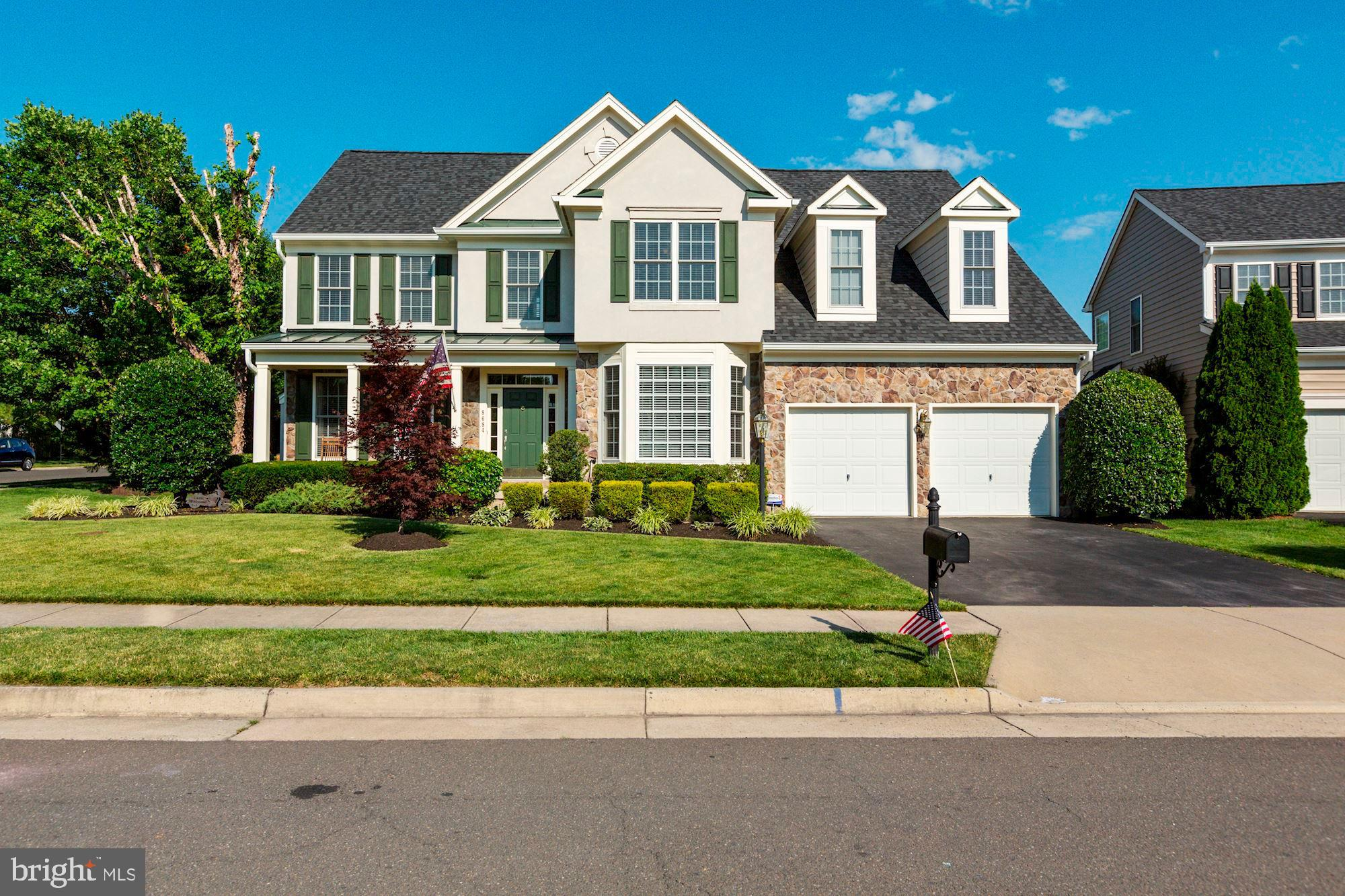 Welcome home! This former model home still shows like a perfect 10! When you drive up you immediately will notice the amazing curb appeal. Enter into your 2 story foyer and to your left you have a formal living room with gas fireplace and spacious formal dining room with bay window.  The kitchen offers double ovens, gas cooktop and eat in space.  This is an open floor plan that leads into your Amazing great room with Stone Fireplace.  Bonus to this home is a sunroom that leads to your composite deck.  To round off the main level you have a half bath and main level office.  Travel upstairs to Huge Master Bedroom with attached sitting room and master bath.  The upper level has 3 additional secondary bedrooms, another full bathroom and upstairs laundry.  Down in your walk up basement you will find a huge rec room, den that could be a 5th bedroom, full bath, and Gigantic Storage Room.  This home has been freshly painted, New Roof in 2019, and Upstairs AC in 2018.  This is a must See