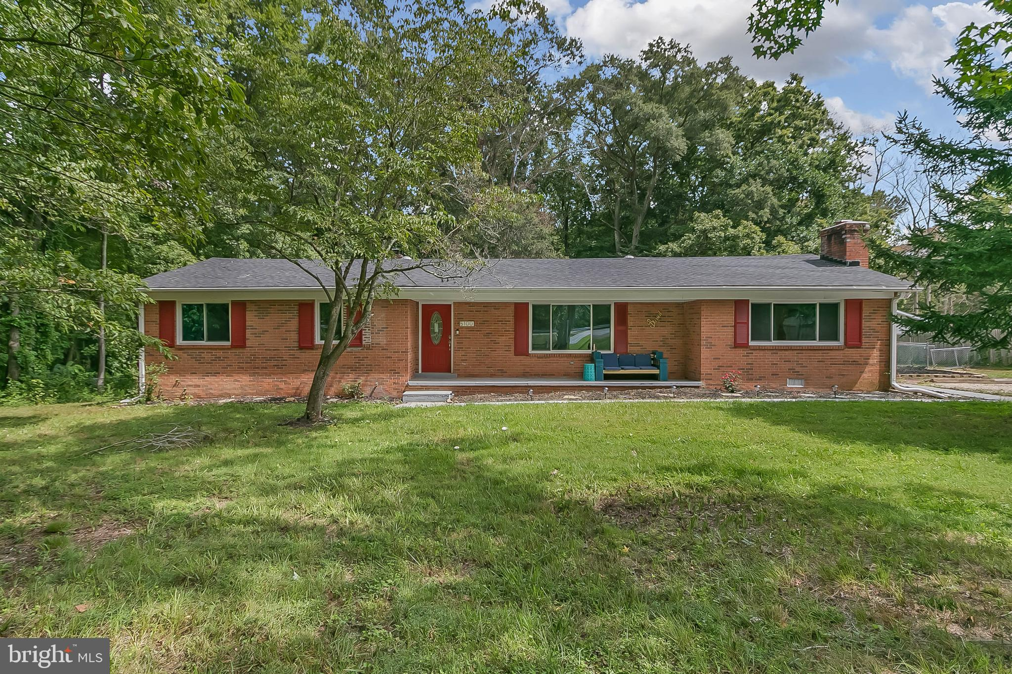 RECENTLY UPDATED BRICK RAMBLER ON LARGE LOT!! Large main level with open layout features hardwood fl