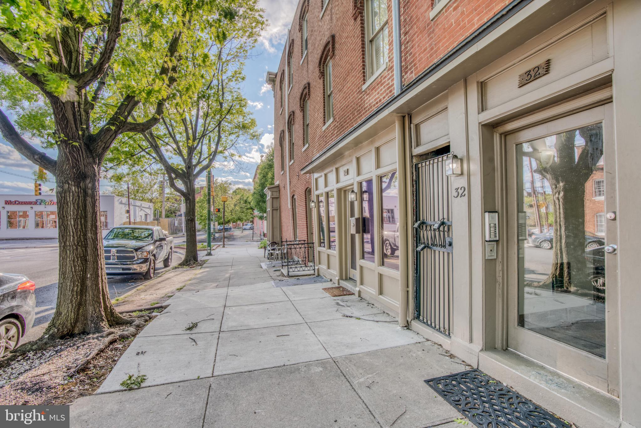 2 Bedroom Condo located in the Historic part of Federal Hill. With a location that can't be matched, It sits a few blocks away from the Harbor, Federal Hill Shops and Restaurants, and Camden Yards. It has off street parking and a roof top deck as well as being close to green space.  The condo has just been painted and boasts gleaming hardwood floors.  The main level has an entryway, bedroom and bathroom, just past that lies the open space kitchen and living area. The kitchen has granite counters and stainless appliances and is connected to the kitchen with a breakfast bar which is great for entertaining. There are many windows that allow lots of natural light to flow through the entire unit.  The upper level contains a spacious bedroom and bathroom as well as a full washer and dryer.