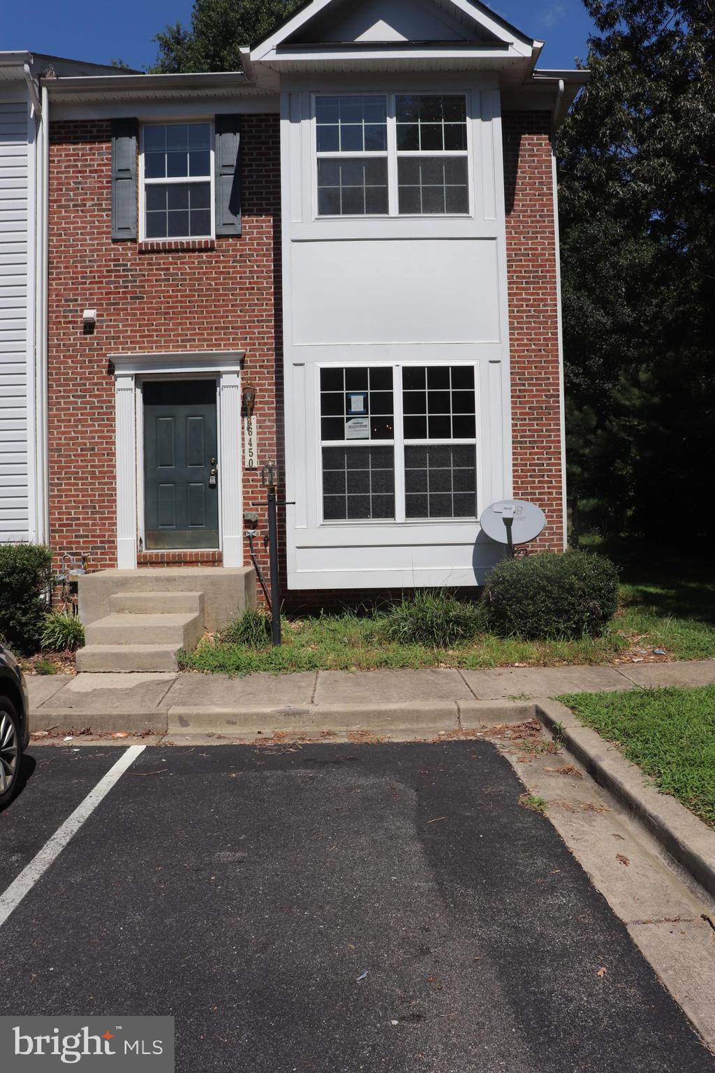 NEW IMPROVED PRICE!!! Nice Brick front town home end unit awaits your finishing touches! Open foyer invites you into open and inviting living room / dining room combination. Continue from the open dining room will lead you into a large kitchen with black appliances, lots of cabinets and counter space, and a breakfast nook. Leave the kitchen and retire to the lower level family room. You will find a Full Bath as well as open floor plan to entertain that includes a fireplace and additional storage. Sliding doors lead to the fenced in back yard that backs to trees. Washer & Dryer also on basement level. Up to the 2nd level for three well kept bedrooms. The Master Bedroom has a nice walk in closet. Off of the Bedroom is the Master Bath with soaking tub, dual vanities, ceramic tile flooring, and separate shower. Don't let this one pass you by or you'll be sorry! Two parking spaces in front of home. Close major highways, shopping, and PAX Naval Air Station (a straight shot to Gate 1, NAS Pax, easiest commute to base!).
