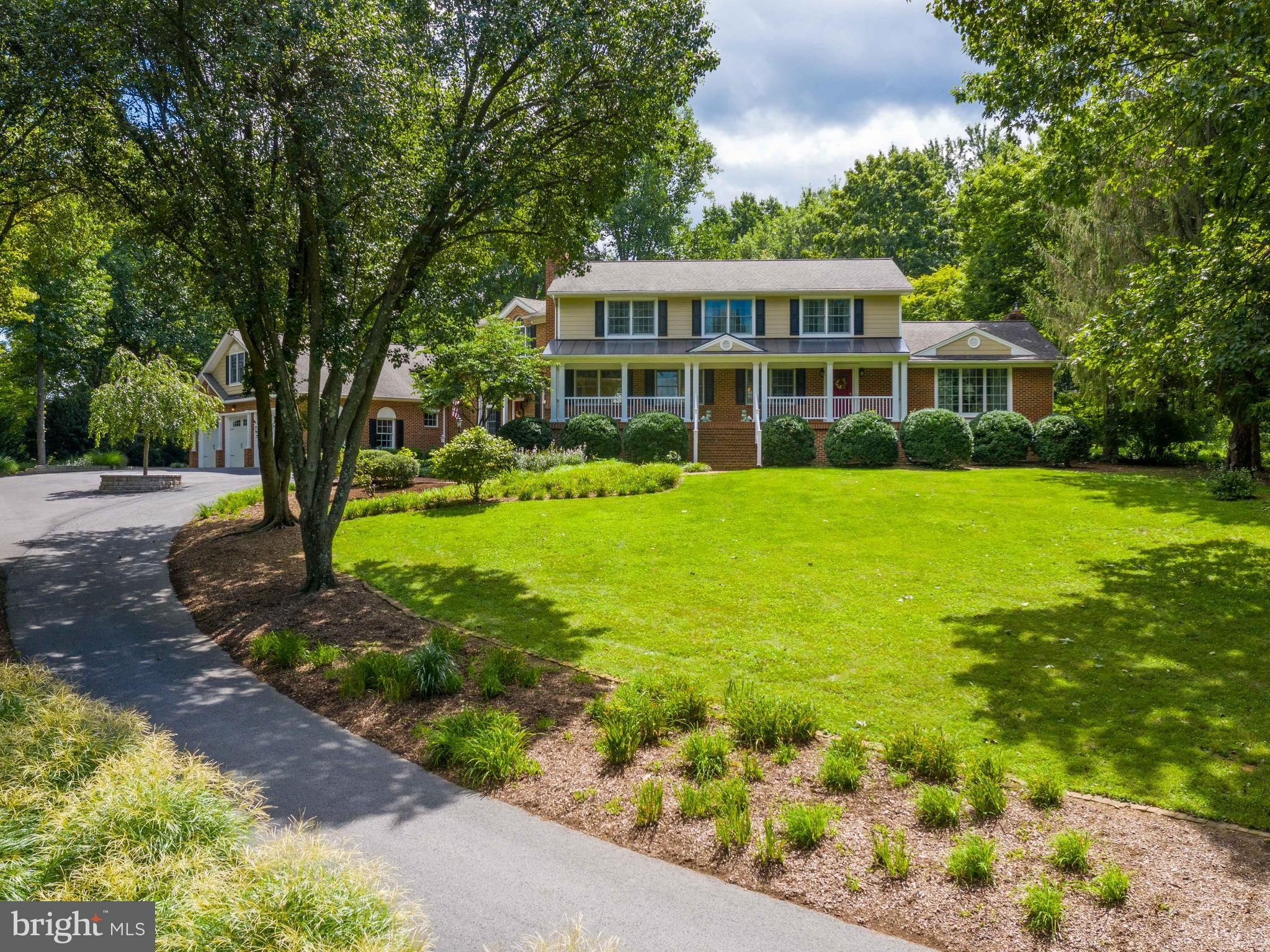 Situated in almost 2 acres of lush, professional landscape and hardscape, this exceptional home is a