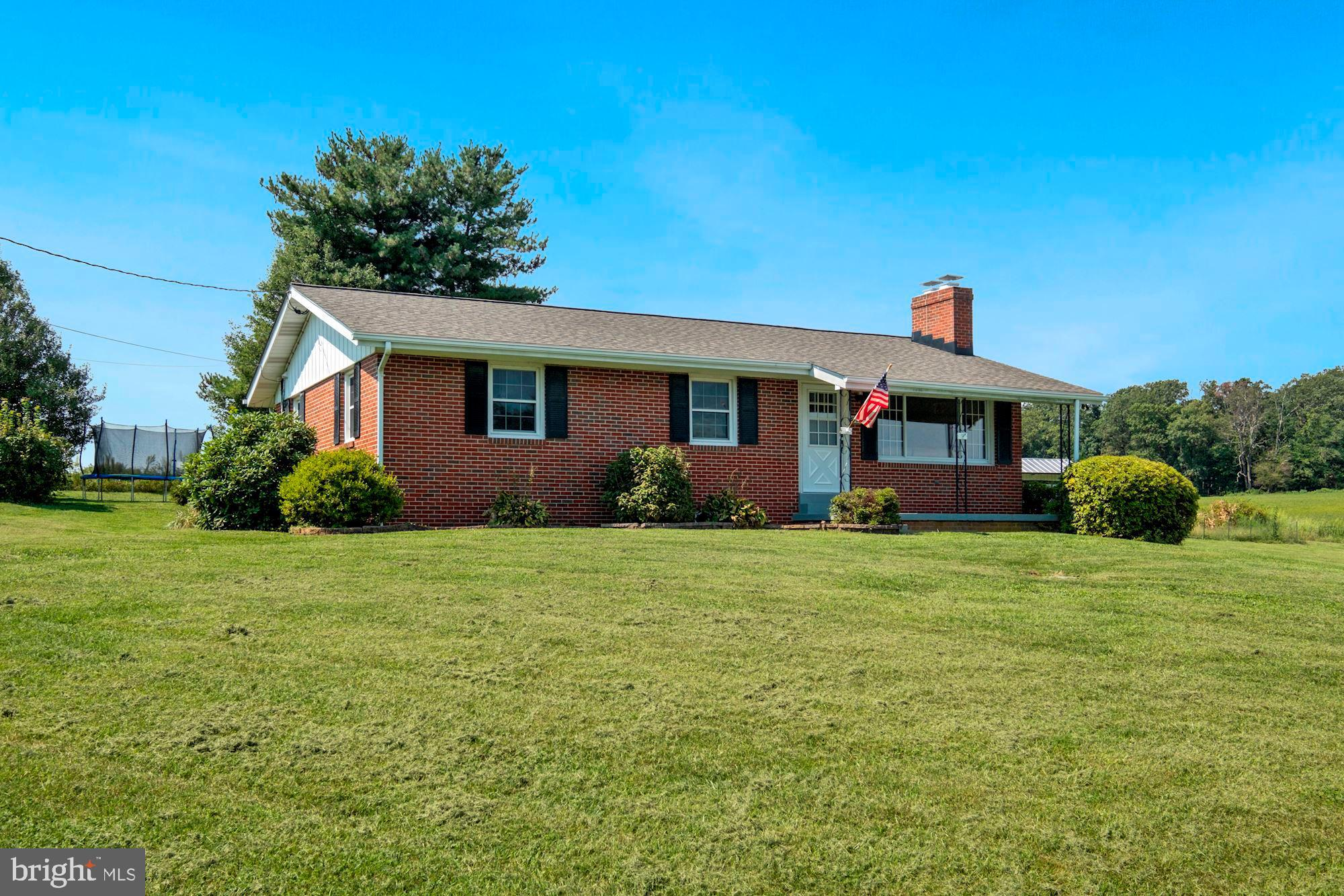Welcome to this well maintained, four bedrooms, and two bath all brick rancher with GORGEOUS RURAL V