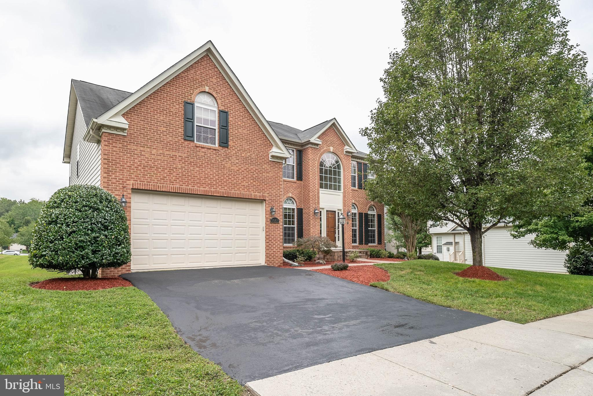 Spacious, well-maintained home with 3 finished levels, 4 bedrooms, and 4.5 bathrooms. The main level