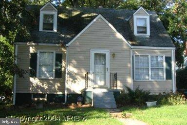Cozy Cape Cod awaiting its new family. Off street parking and a park like backyard.  This is an As-Is sale.