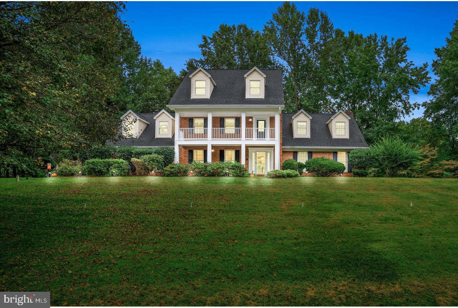 Spectacular 5 bedroom 4.5 bath Southern Colonial sitting on almost an acre and located in the sought
