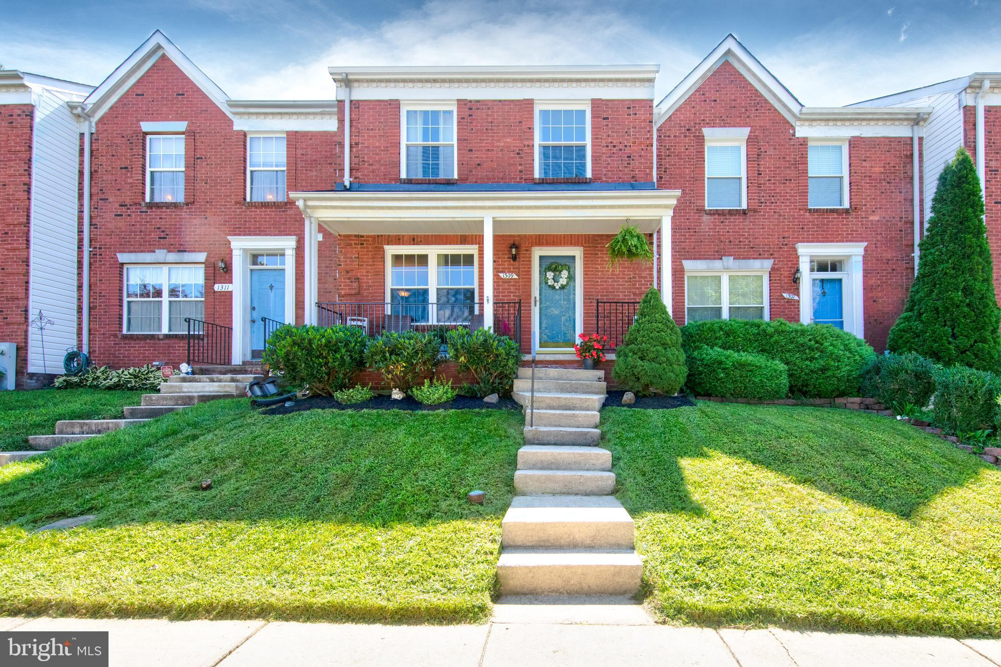 Beautiful brick-front townhome located in a quiet court! A spacious front porch greets you as soon a