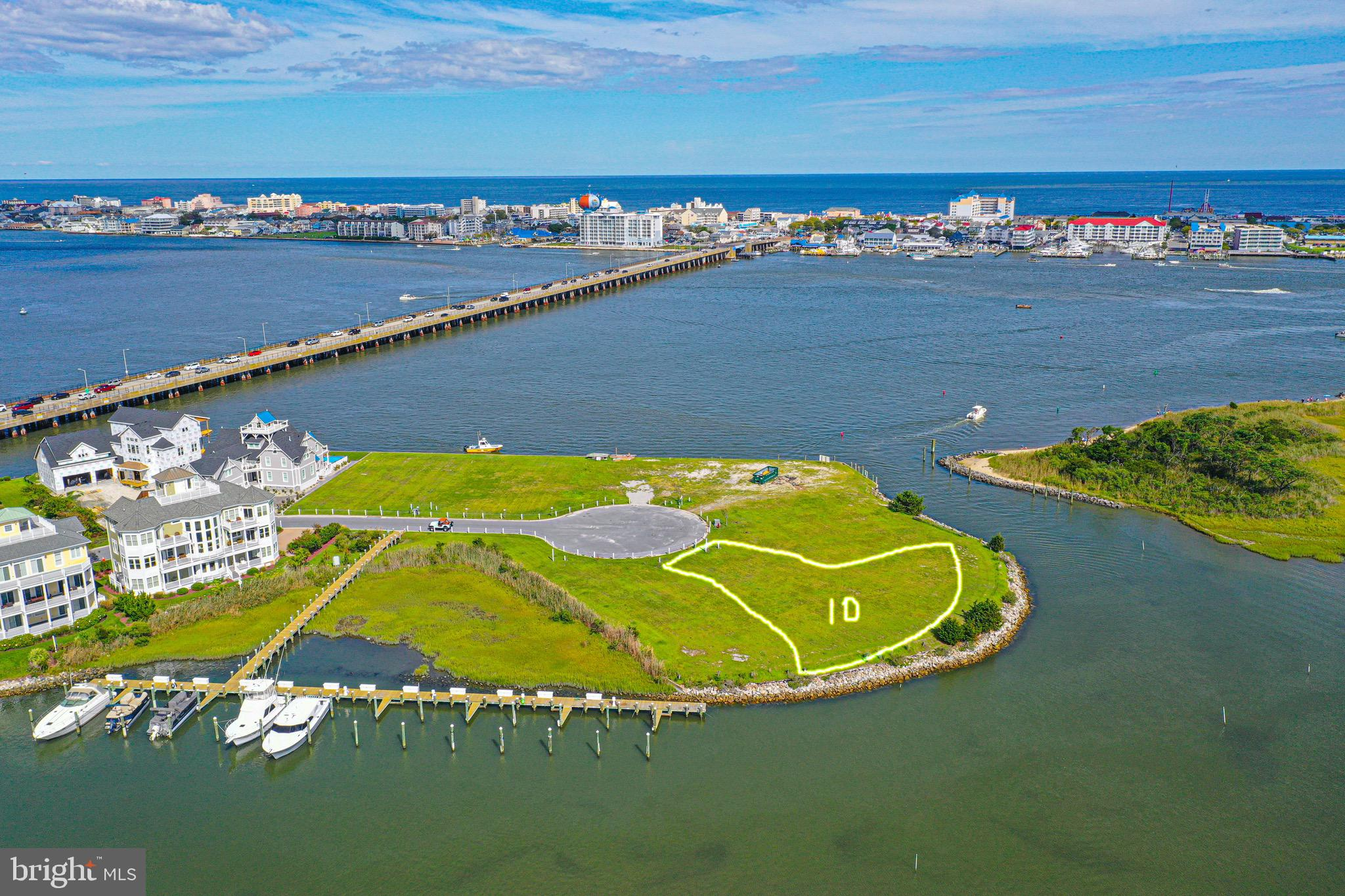 Premium waterfront lot located in a much sought after West Ocean City exclusive and private community.   Panoramic views of the ocean city inlet, ocean, and marina.  Lot conveys with a 42 ft, boat slip located inside a protective basin.  Lot 11 is also available for purchase, see mls number MDWO115502.  Lots are side-by-side and they are the  two largest lots remaining in the development.  Contact listing agent for more information and most accurate details about the property.