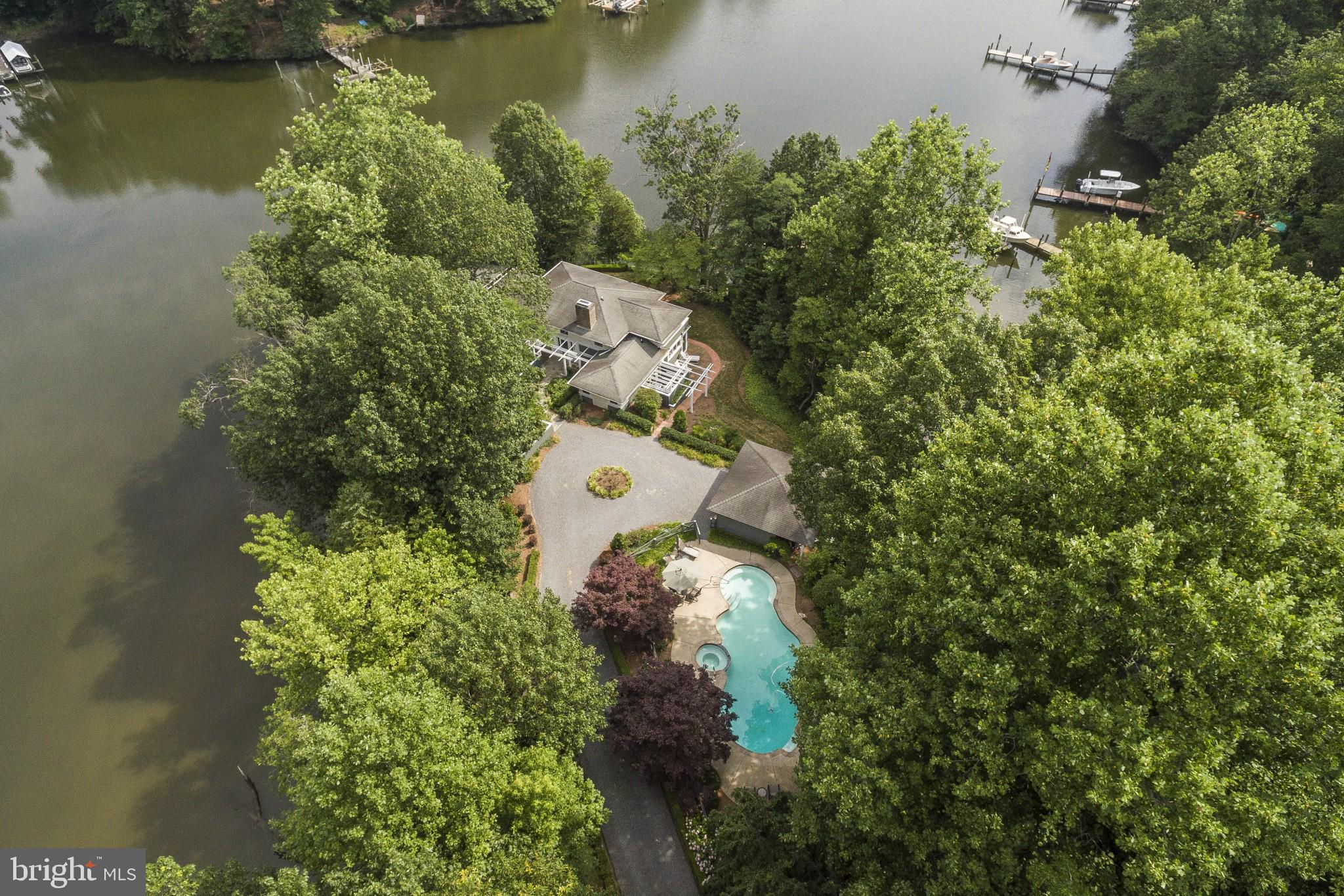 QUINTESSENTIAL ESCAPE. This waterfront residence in Southern Maryland is nestled into a very private