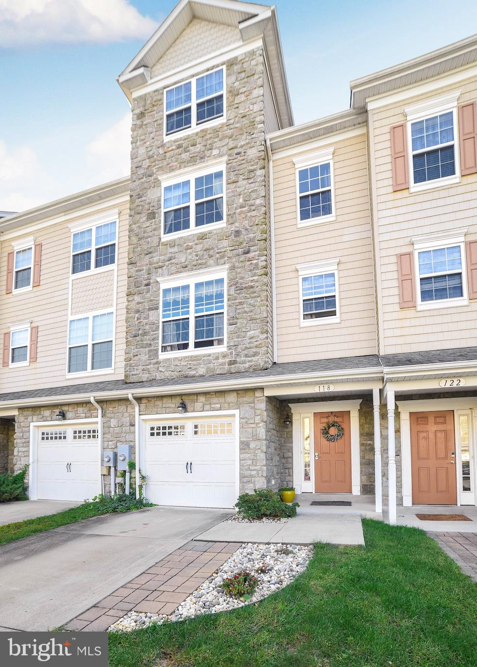 Beautiful, well maintained 3 bedroom,  4 bath townhouse with garage located in Prince Frederick Wood