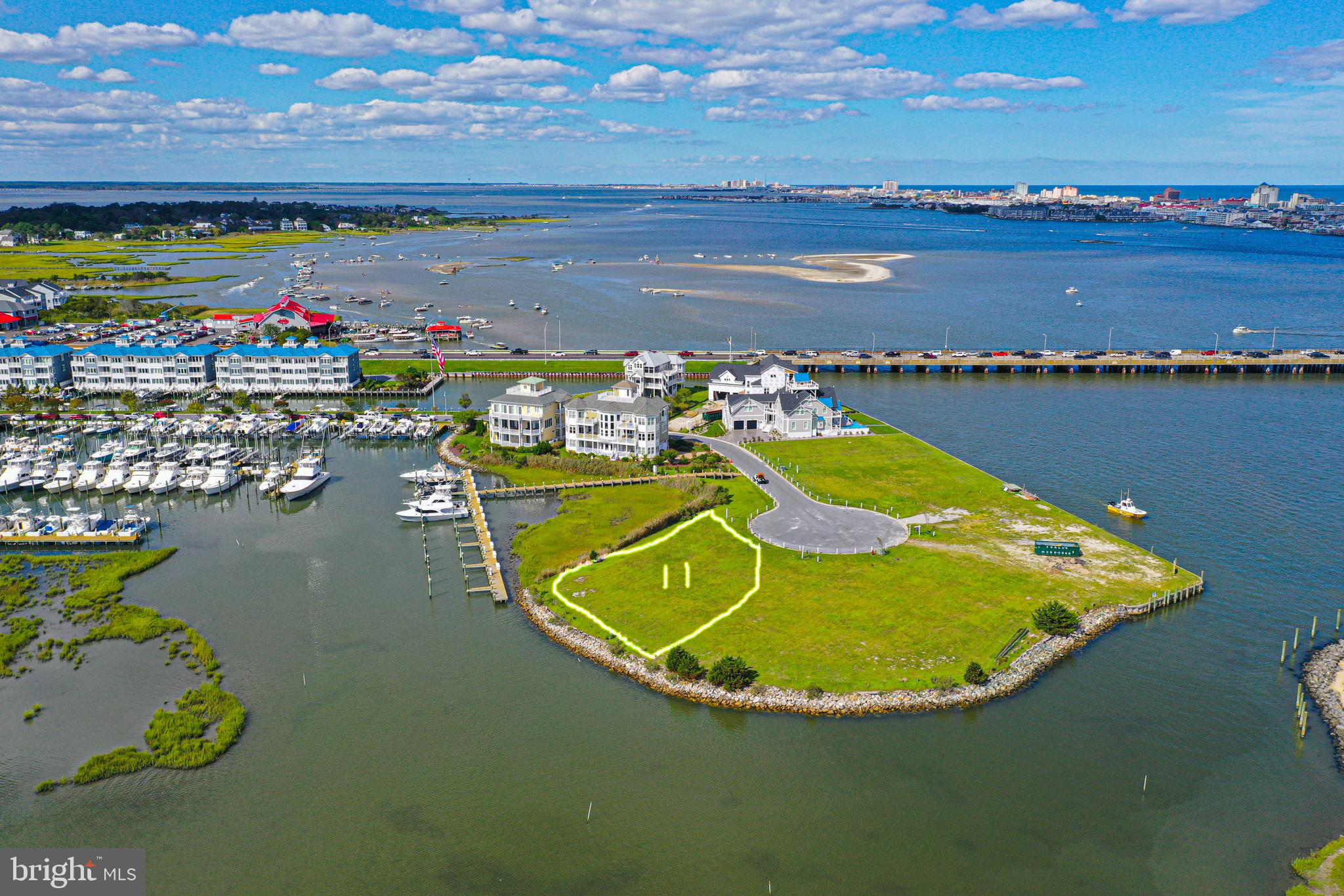 Premium waterfront lot located in a much sought after West Ocean City exclusive and private community. Panoramic views of the ocean city inlet, ocean, and marina. Lot conveys with a 42 ft, boat slip located inside a protective basin. Lot 10 is also available for purchase, see mls number MDWO116466. Lots are side-by-side. Contact listing agent for more information and most accurate details about the property.