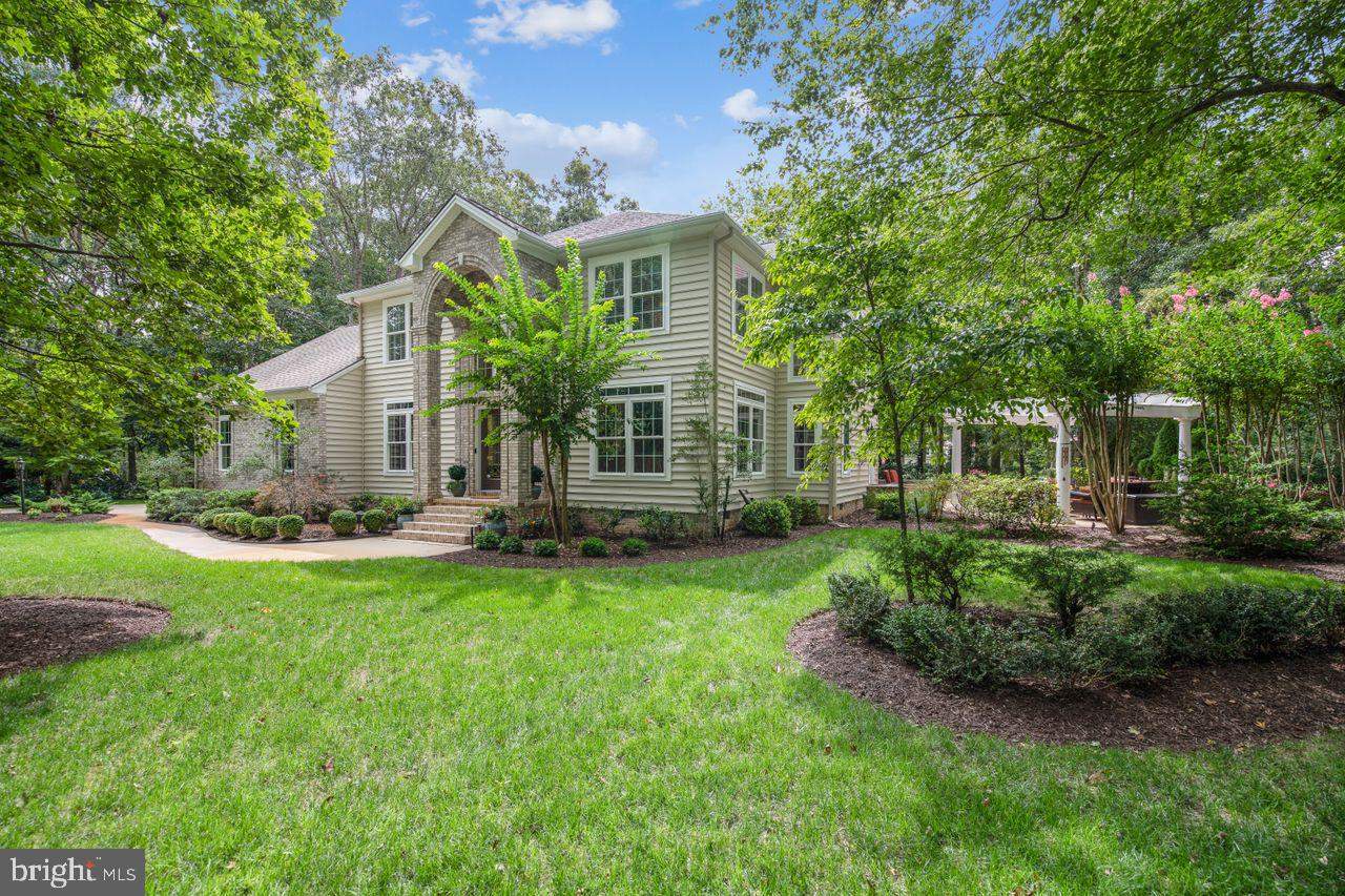Nestled among the trees on a pristine .78 acre lot, this beautiful 3746 SF residence is brimming w/