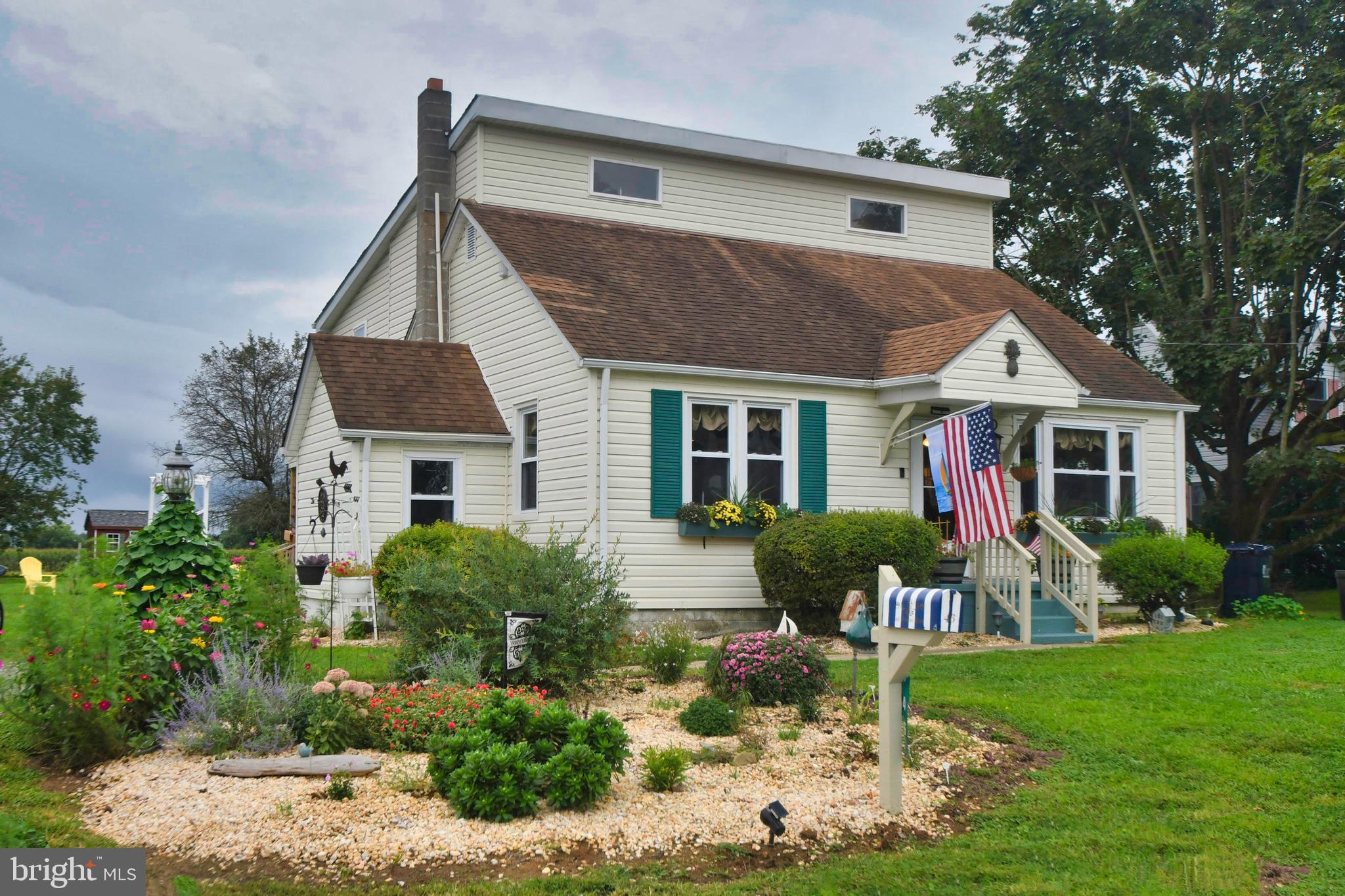 """YESTERDAY MEETS TODAY!   Charming and Remodeled...This """"Cape Cod""""  home features 4 bedrooms, hefty s"""