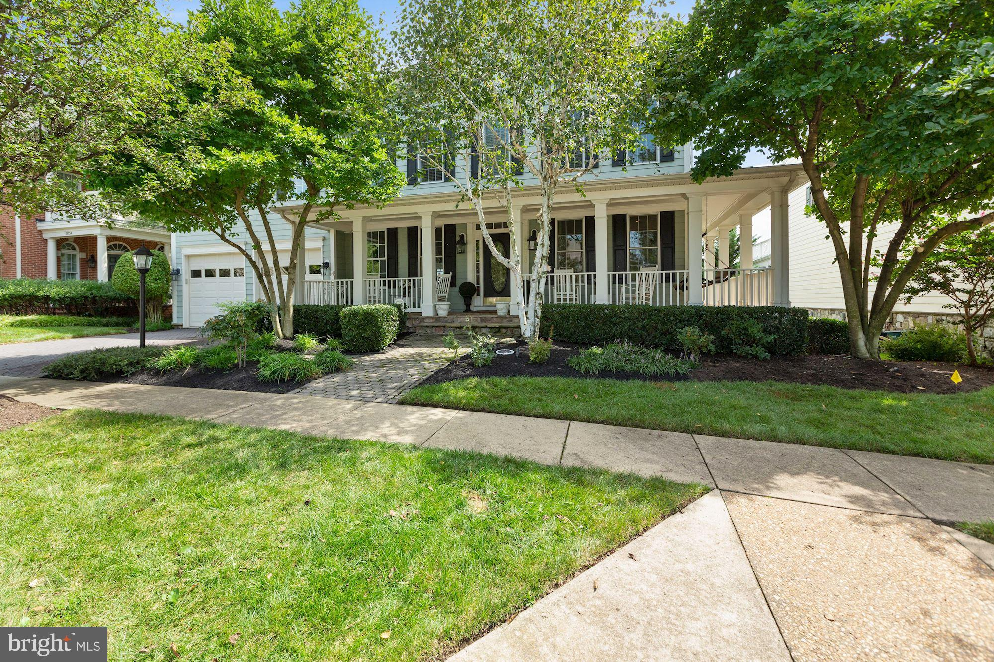 **Open House Sunday September 6th from 1-3 P.M.** This amazing property was the original Van Metre Model Home with every bell and whistle possible.  The paver-lead walk and custom landscaping welcome you to the inviting wrap around front porch.  The rear yard features the best golf course view in Lansdowne with a Trex deck, screened in porch, extensive stone patios, an incredible gold fish pond with custom bridge.  The estate's interior features over 5,600 finished square feet featuring opulent formal spaces with wide plank hardwood floors with custom tile inlay. There are 4 fireplaces in the living room, family room, recreation room and owner's suite.   All four bedrooms include spacious closets and Bedroom 4 with an en-suite bath.   All baths feature upgraded tile and upgraded cabinets and fixtures. The Owner's bath is freshly updated and includes his and hers walk-in closets and abundant natural light. The completely finished lower level includes a spacious Recreation Room, Billiards Room, Game/Play Room 5th Bedroom and full bath . This home has been lovingly maintained and very lightly lived in.  Nearly the entire home has been freshly painted.  Enjoy this award-winning community and its amenities and the most premium lot situated beautifully along the 9th hole of the RTJ golf course and views of hole 1 and 10.  This is a one of a kind and will not disappoint!