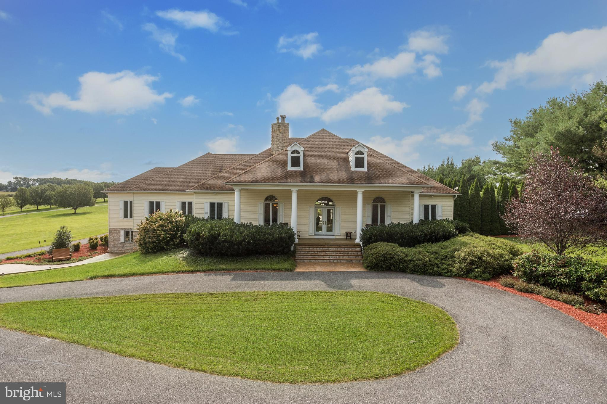 Stunning Custom Built Rancher Boasting Sundrenched Lofty Windows, Arched Doorways, Expansive In-Law