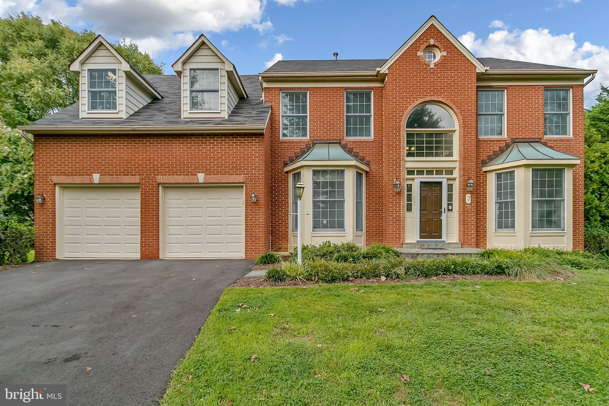 Beautiful brick front colonial in sought-after Rose Hill Falls community. Convenient location, easy