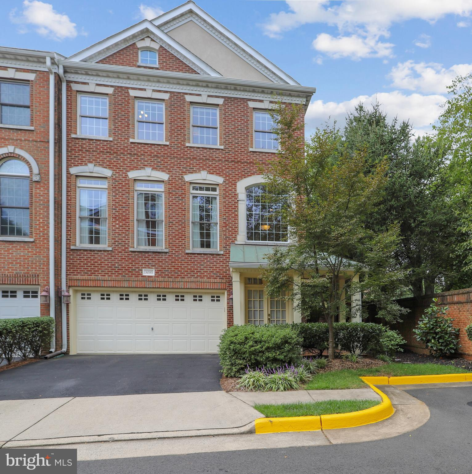 Don't miss this beautiful, spacious and sun-filled 3 BR, 3.5 bath all brick, end-unit town home in heart of Oakton!  This executive style town home boasts tall ceilings, large windows, hardwood floors, a 2 car garage with storage space, 2 zone HVAC and bedroom level laundry!  Open floor plan with gourmet kitchen, double ovens, breakfast bar, large pantry and double ovens and gas stove, dining room, living room with gas fire place and family room all on the main level.  Freshly painted  deck off living room with stairs to the slate patio, pond & waterfall feature and wonderfully landscaped, fenced yard. Upper level has a spacious master bedroom suite with walk in closet, tray ceiling. large bay window and beautifully updated spa-like master bath with dual sinks and separate bath and shower.  Two more bedrooms and finely updated 2nd bath also on the upper level.  Lower level has a private fully finished walk out basement with full bath and 2nd gas fireplace is perfect for an office, bedroom or home theater!  Roof 2019  Walkable to shops, restaurants and a bus to Tysons.  Minutes to 66, 50 and to Vienna METRO and Oak Marr Rec Center.  Oakton HS Pyramid and less than 1 mile to Flint Hill, *Schedule via Showing Time, *Use Covid Precautions when showing