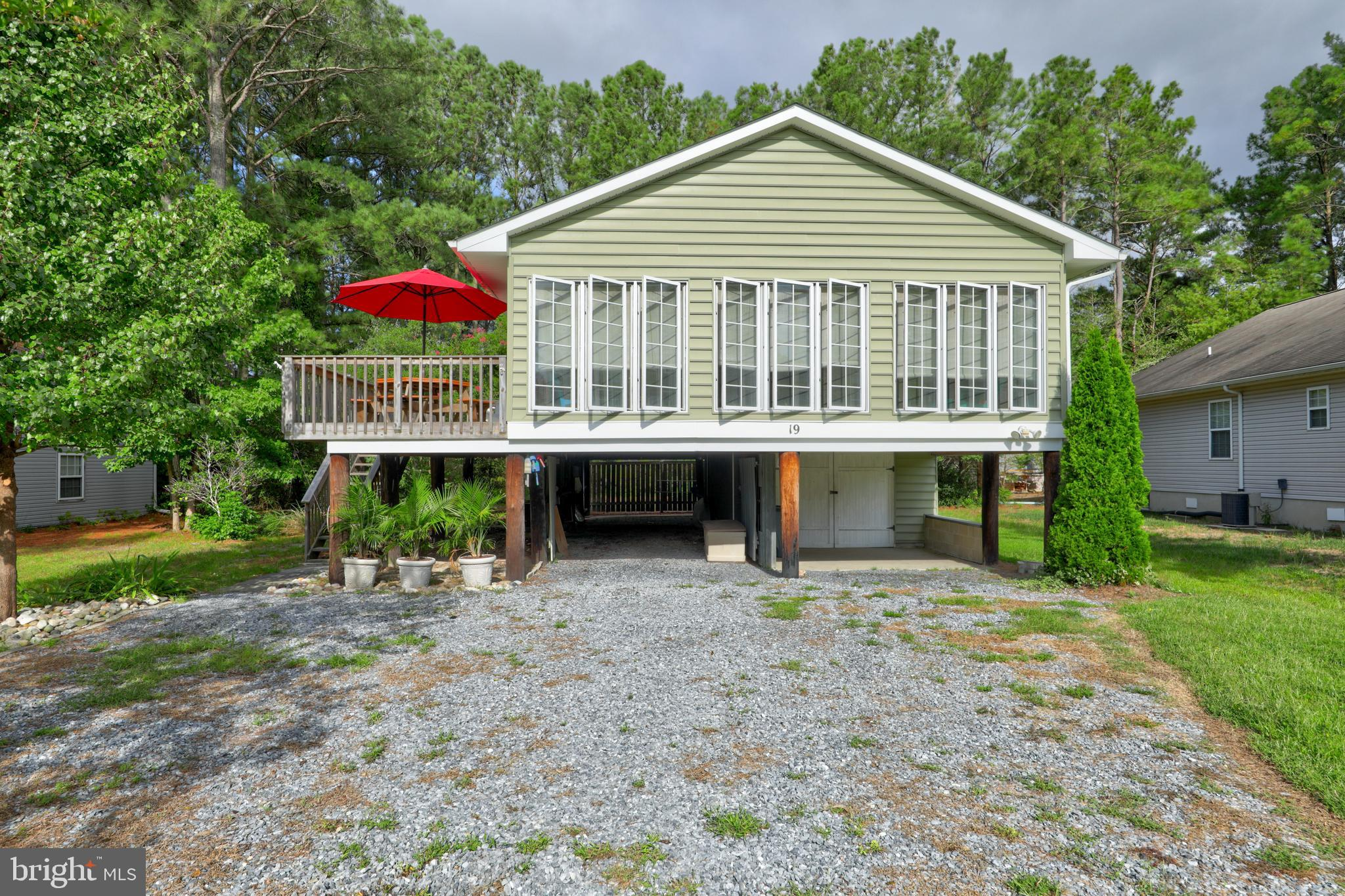 Quintessential Beach Cottage. Excellent location for this raised rancher across the street from the St. Martins River in the very sought after Teal Bay neighborhood in Ocean Pines! Being sold furnished except for a few exclusions - see disclosures. From the moment you pull into your driveway - you know you are at the beach! You have a one-car garage and additional covered parking. Great lower level storage (for all your water & beach toys) and an outdoor shower. Up the steps, you have an ample sized sun deck - which is great for entertaining. The home has an open floor plan with a sunny Florida room with floor to ceiling windows. Never rented and used as a summer vacation home. The roof was just replaced in September 2020! Lovely updates include new vinyl siding, new plantation shutters, added breakfast nook in the kitchen area, new hot water heater, new washing machine, large custom-crafted outdoor shower, and new gutters. Come check out this unique, adorable beach home! ** Ocean Pines Information**  Ocean Pines is a residential community nestled on Maryland's Eastern Shore in northern Worcester County, featuring more than nine miles of waterfront property on 3,000 acres of wooded areas. Amenities include a beachfront restaurant in Ocean City,  and a public Yacht Club in Ocean Pines. There are also five pools, two marinas, a premier racquet sports complex, and a Robert Trent Jones Sr.-designed championship golf course. Originally established in 1968, today the community has 8,452 platted lots and is home to 12,000 full-time residents and 8,000 part-time residents and guests. In addition,  Ocean Pines has two separate boat launch areas, kayak,  and paddleboard launch areas, bike trails,  multiple recreational parks with picnic and playground areas.