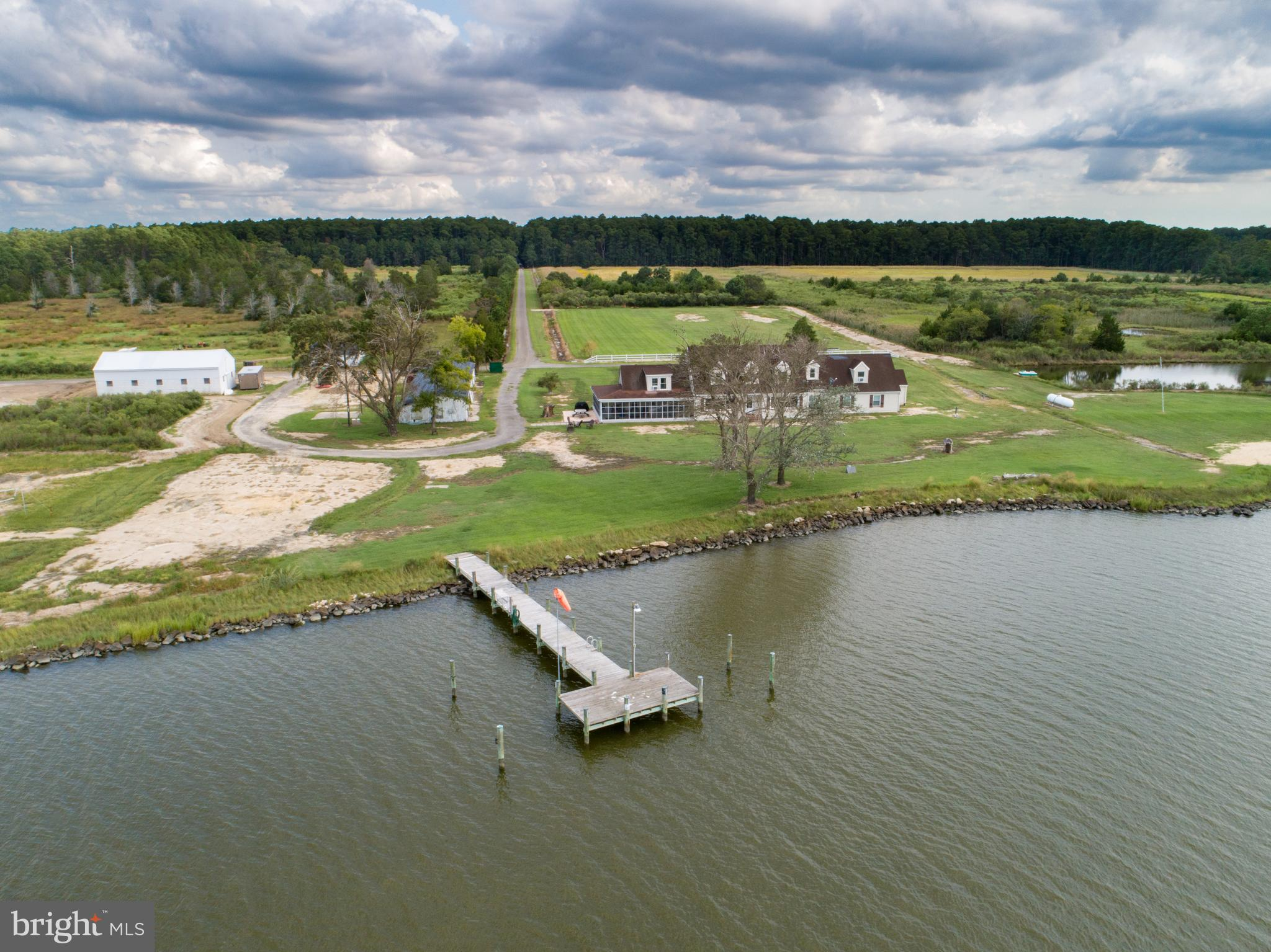 NEW PRICE!  THE SERIOUS OUTDOORSMAN/HUNTER OR NATURE ENTHUSIAST WILL LOVE THIS PRIVATE AND SECLUDED WATERFRONT SETTING ON  357 +/- ACRES.  8000 FT (approx 1.5 miles) OF WATER FRONTAGE ON THE LITTLE CHOPTANK & SMITH COVE WITH SPECTACULAR SUNSETS.  A GATED ENTRY  LEADS TO A PRIVATE TREE LINED  ONE MILE DRIVE OPENING TO FIELDS AND WATER.  BOATERS WILL ENJOY THE TWO MULTI SLIP PIERS, BOATHOUSE, AND  SANDY BEACH TO LAUNCH THEIR CANOES & KAYAKS.  THE 5 BR  RUSTIC FARMHOUSE WITH A WRAP AROUND PORCH  HAS HAD WINDOWS AND HVAC REPLACED. THE OVERSIZED GARAGE & OUTBUILDINGS ARE IDEAL FOR FARM/BOATING/HUNTING  EQUIPMENT & STORAGE.  THE MAIN HOUSE  SLEEPS 15+ & HAS AN ESTABLISHED HISTORY OF RENTAL INCOME +/- $2995 PER WEEK IN SUMMERTIME.  THE 2 BR 1 FULL BATH TENANT HOUSE (OR CARETAKERS HOUSE)  HAS A NEW ROOF (FEB 2020) & NEWER KITCHEN, DECK & SHED  OVERLOOKING THE WATER.  THREE LOTS. 7 MILES  AWAY FROM THE HYATT REGENCY (WITH CHAMPIONSHIP GOLF), SHOPPING, RESTAURANTS & THE BLACKWATER NATIONAL WILDLIFE REFUGE.  PLENTIFUL DEER (WHITETAIL & SIKA), BALD EAGLES, TURKEYS, FOXES, BIRDS, ETC.  SOME FIELDS CURRENTLY BEING FARMED (MILO & MILLET). SEE DISCLOSURES FOR SPECIFIC INFO REGARDING PROPERTY.  SELLER TO ACCOMPANY ALL SHOWINGS & WILL GIVE YOU THE TOUR ON THE MOTORIZED MULE!
