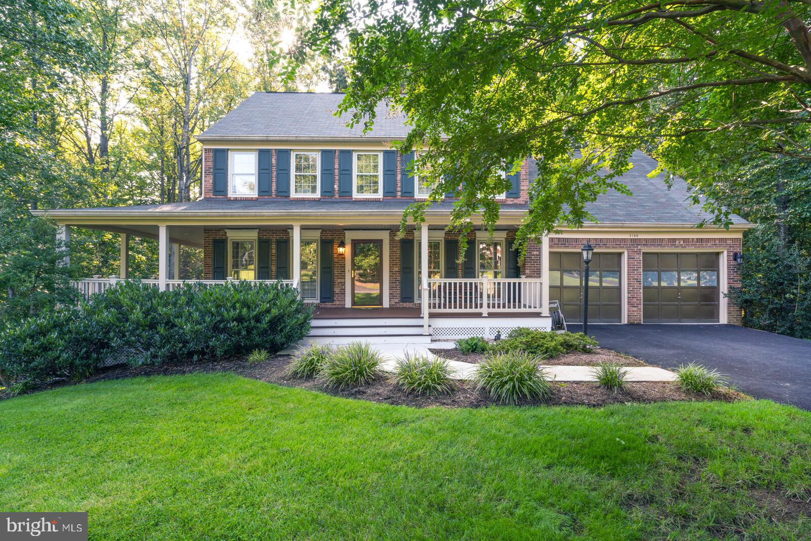Welcome home to this beautifully appointed classic colonial tucked away on a secluded & private near
