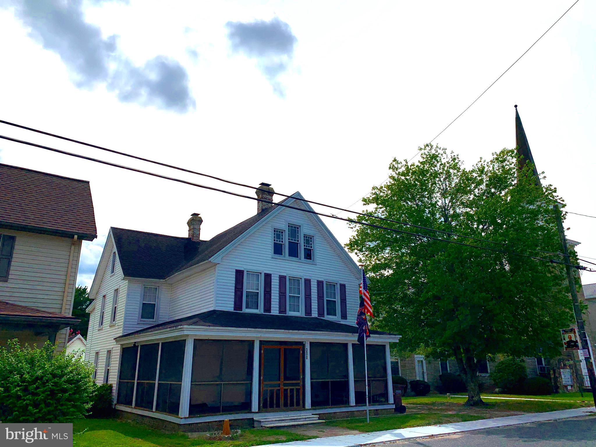 Charming circa 1916 home in quiet small town features new laminate flooring, two fireplaces, pellet
