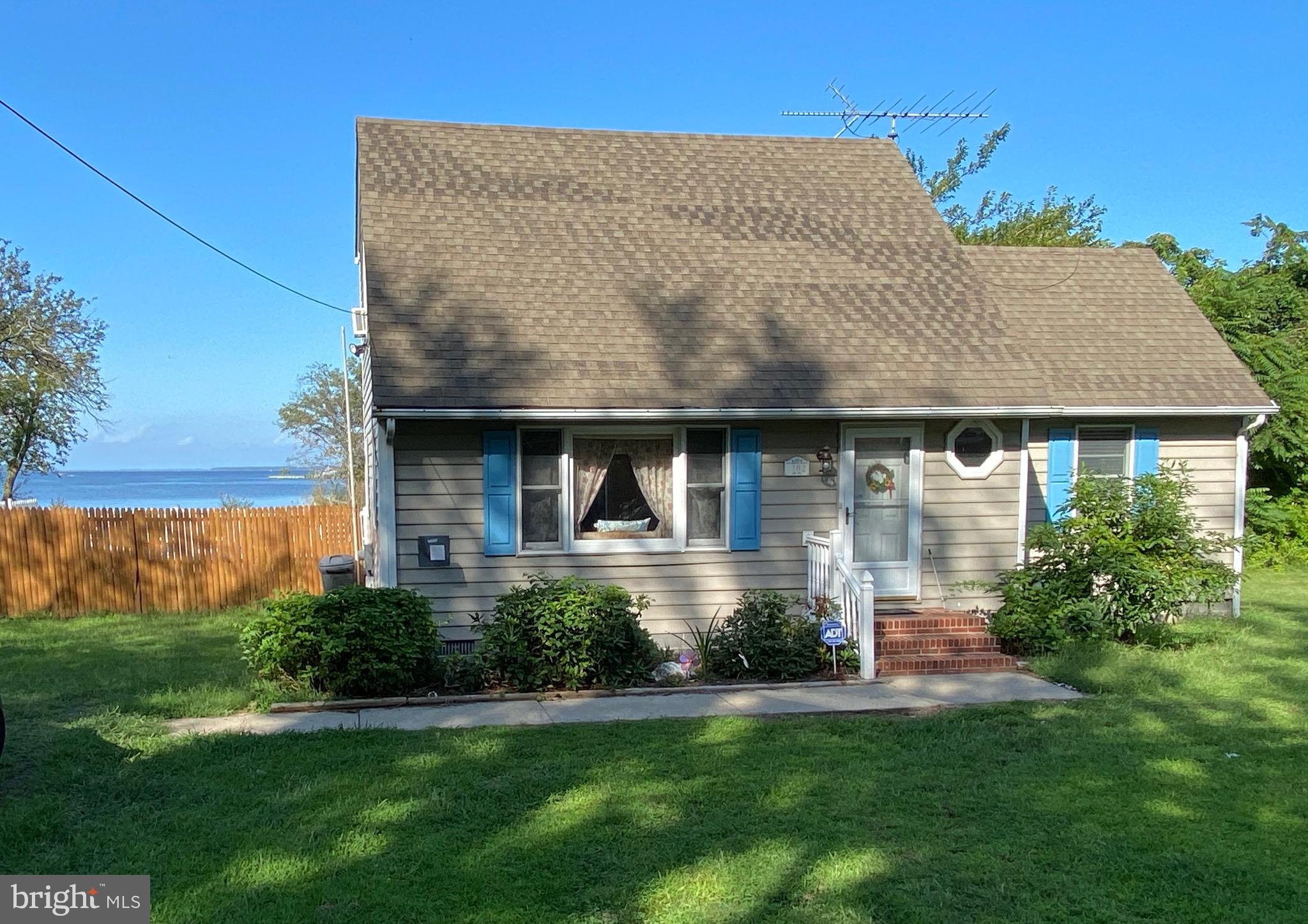 Water front, Jackson Creek, just shy of an acre corner lot! This charming Cape Cod home is waiting f