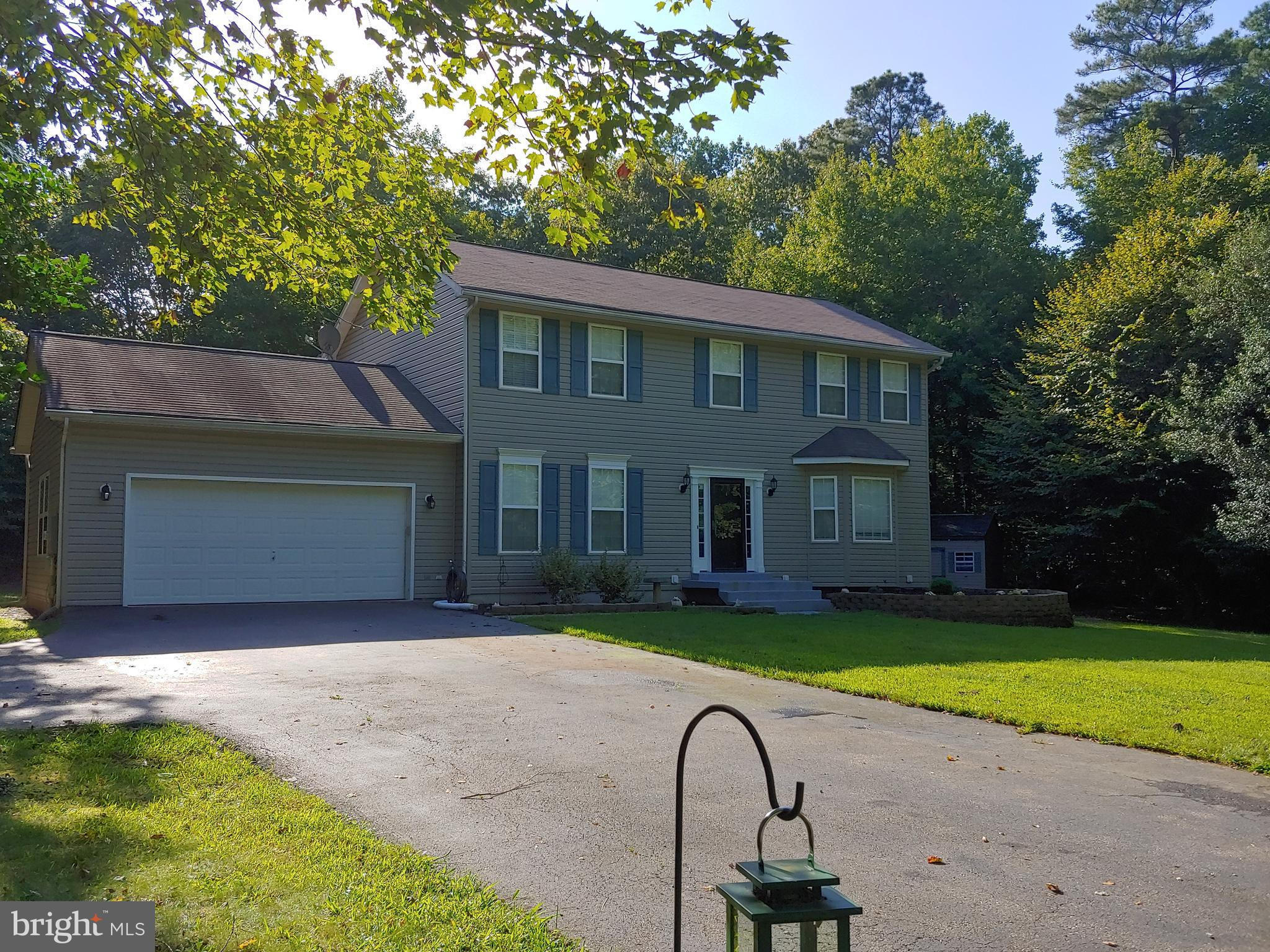 This is a must see property over 2 acres backing up to Conservation Forest area. This 4 Bedroom 2 fu