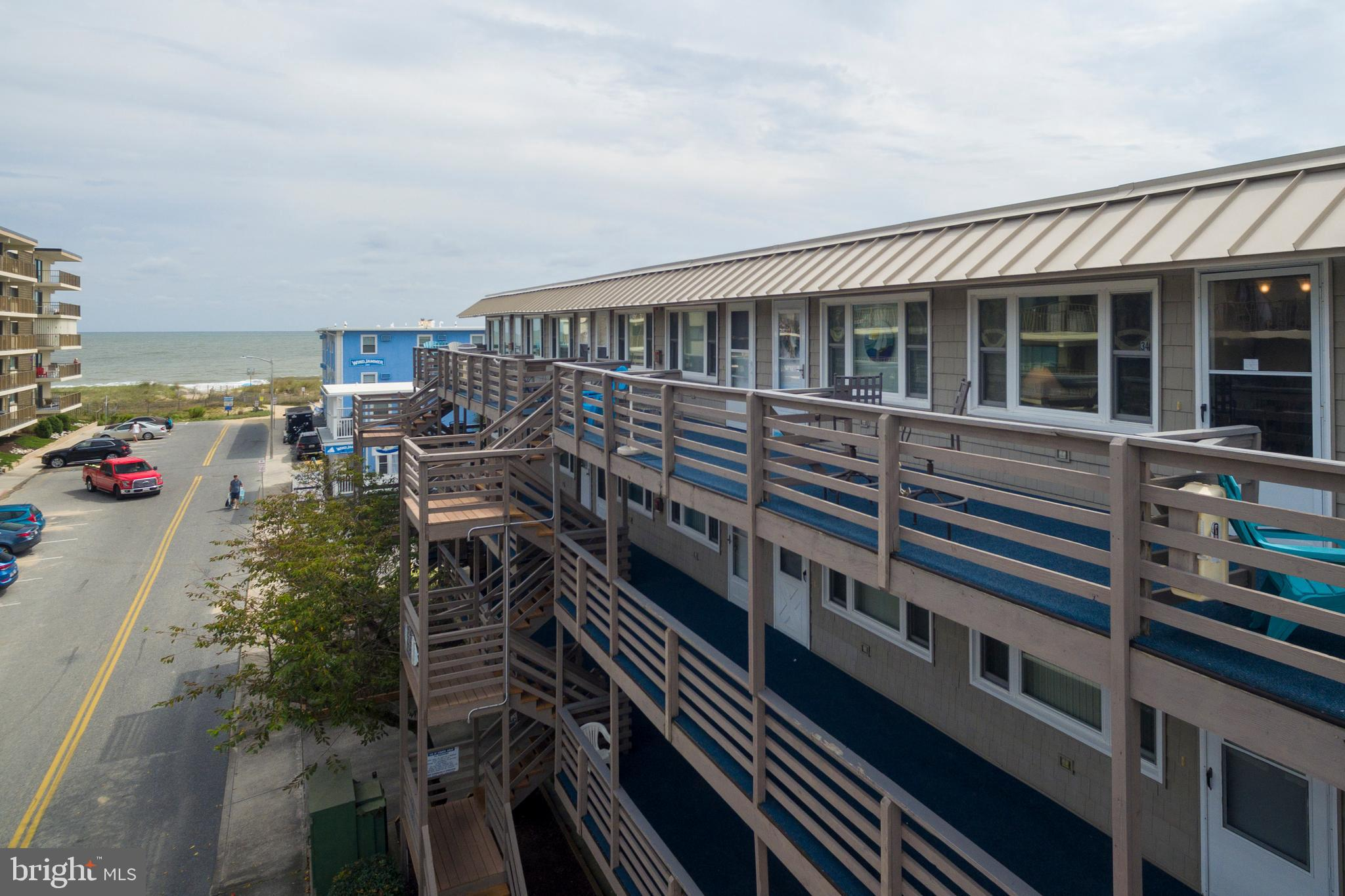 Very affordable ocean block condo that has great views from the balcony! Owners have just replaced hot water heater (9/2020) and stove, refrigerator, washer/dryer and HVAC in 2017. Also has newer windows. This condo has been loved and been well maintained by owners and now it's ready for a new owner to make new beach memories. Only steps to the beach and sand, you can hear and see ocean from balcony. Located in popular mid-town, the location offers lots of restaurants (just within a couple blocks) with ice cream, crabs, subs, burgers, seafood, wine/cheese, Irish Pub and more. Also is close to mini golf, water sports rentals, entertainment and night life. Plus, conveniently a few blocks from the Convention Center, too. This part of town has low density beach, so has less crowds. Makes for the perfect beach getaway or a successful rental. Building offers a solid condo association with off street parking. Don't miss out on the low interest rates and make this your new beach place!
