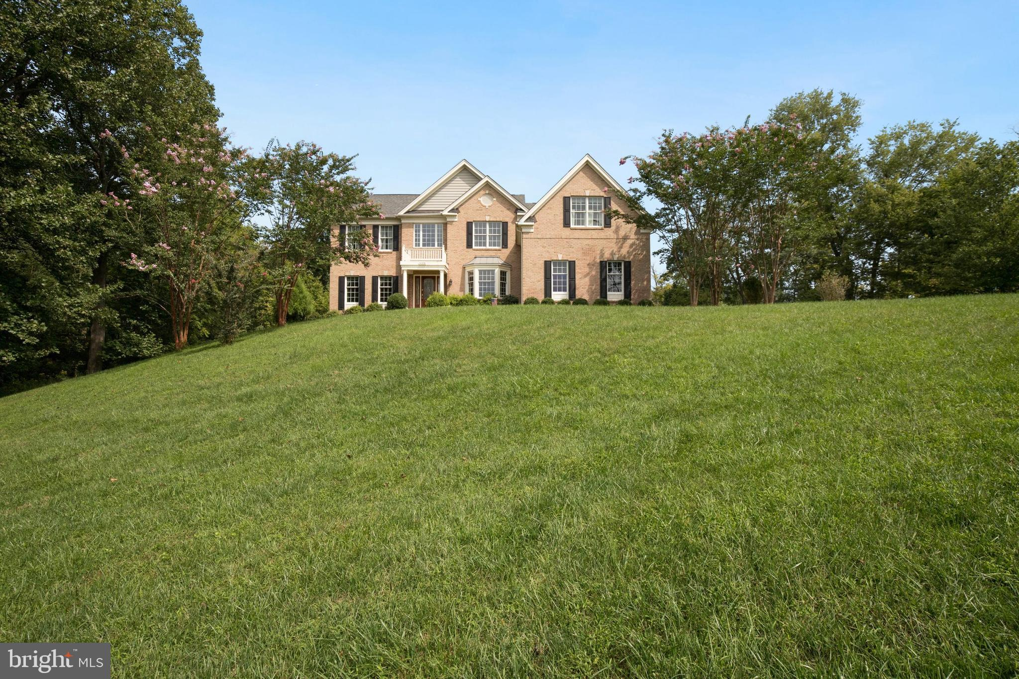 Stunning Toll Brothers Langley model estate situated on an incredible 3 and a half acre lot surround