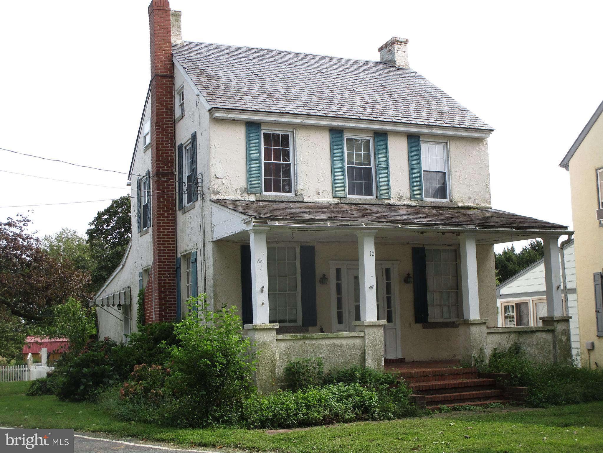 Brick home with stucco interior located in historic Calvert.  This 1825 home has  3 bedrooms, 1.5 ba