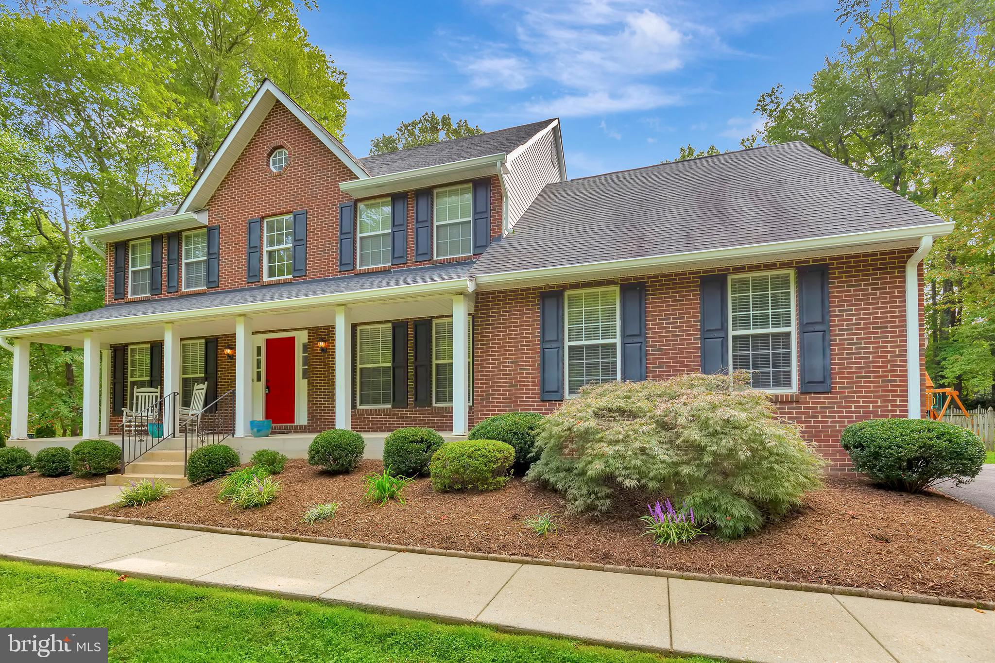 This lot! This house! This location! A brick front classic in northern Calvert County offering commu