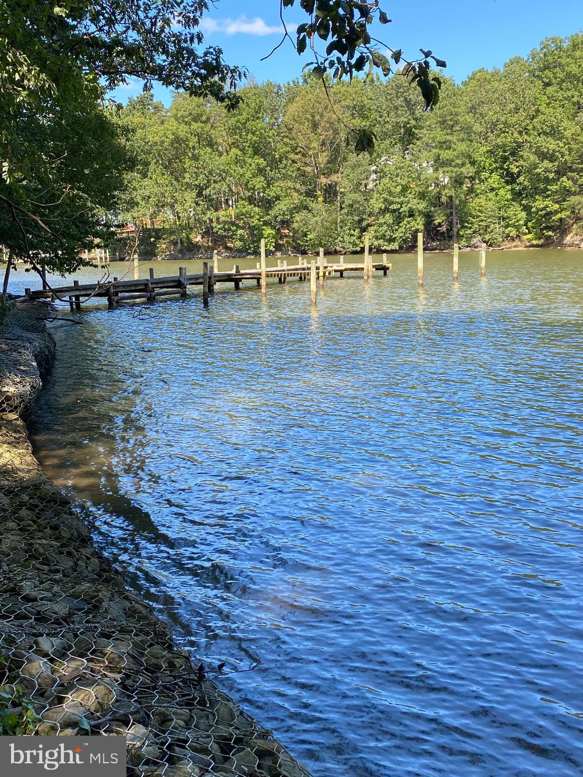 WATERFRONT with DEEP WATER PIER......Loads of potential in  this  1700+/- sf contemporary/ 3  big be