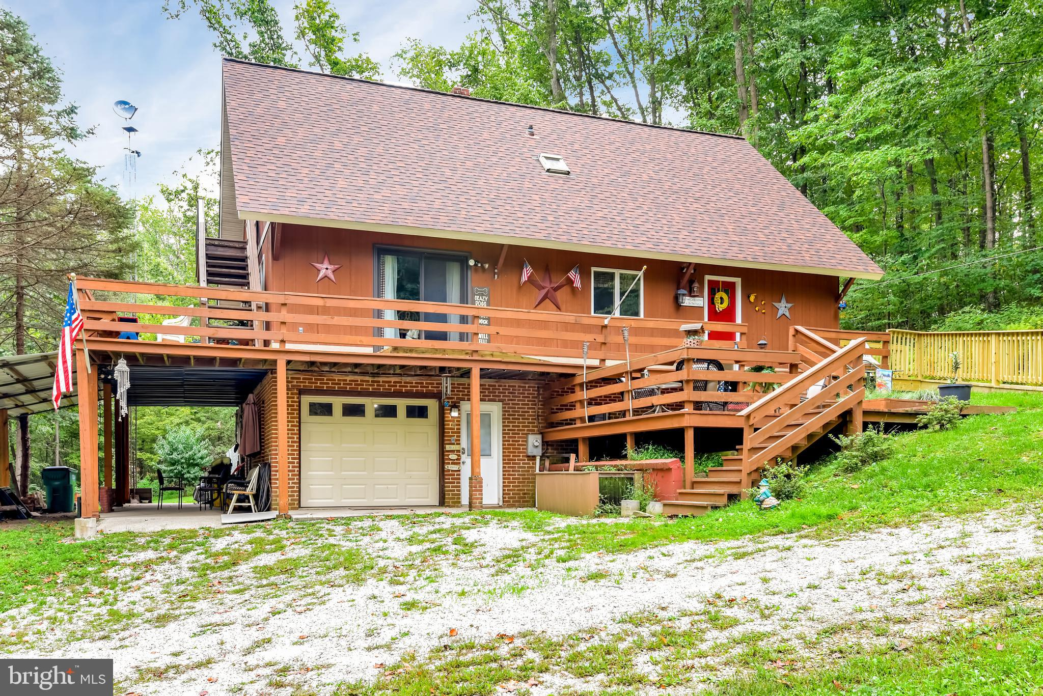 Your idyllic Carroll County private retreat surrounded by over 5 acres of nature awaits. This beauti