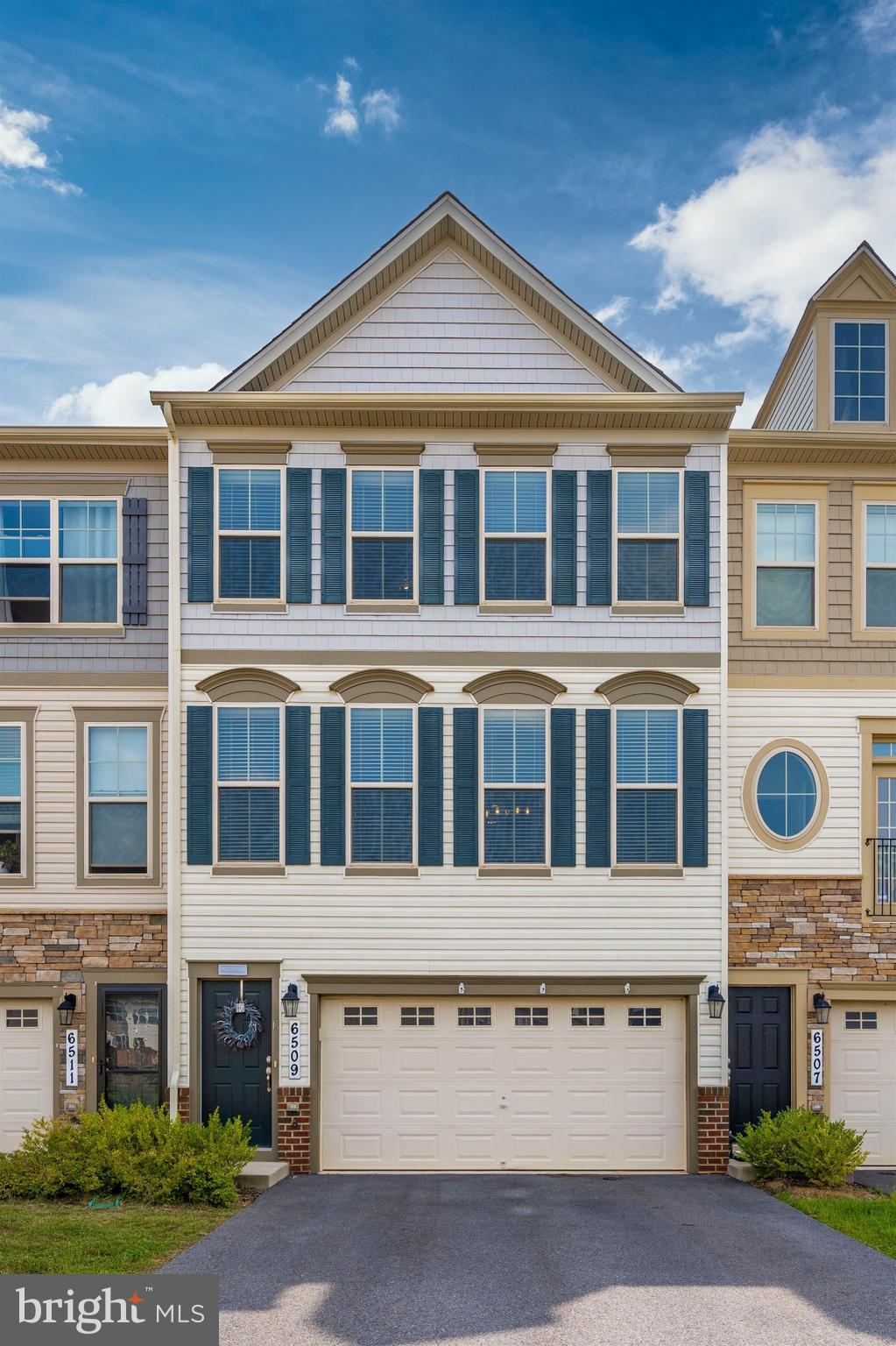 Gorgeous townhome in Manors at Ballenger Creek community. With three-level living, this home offers