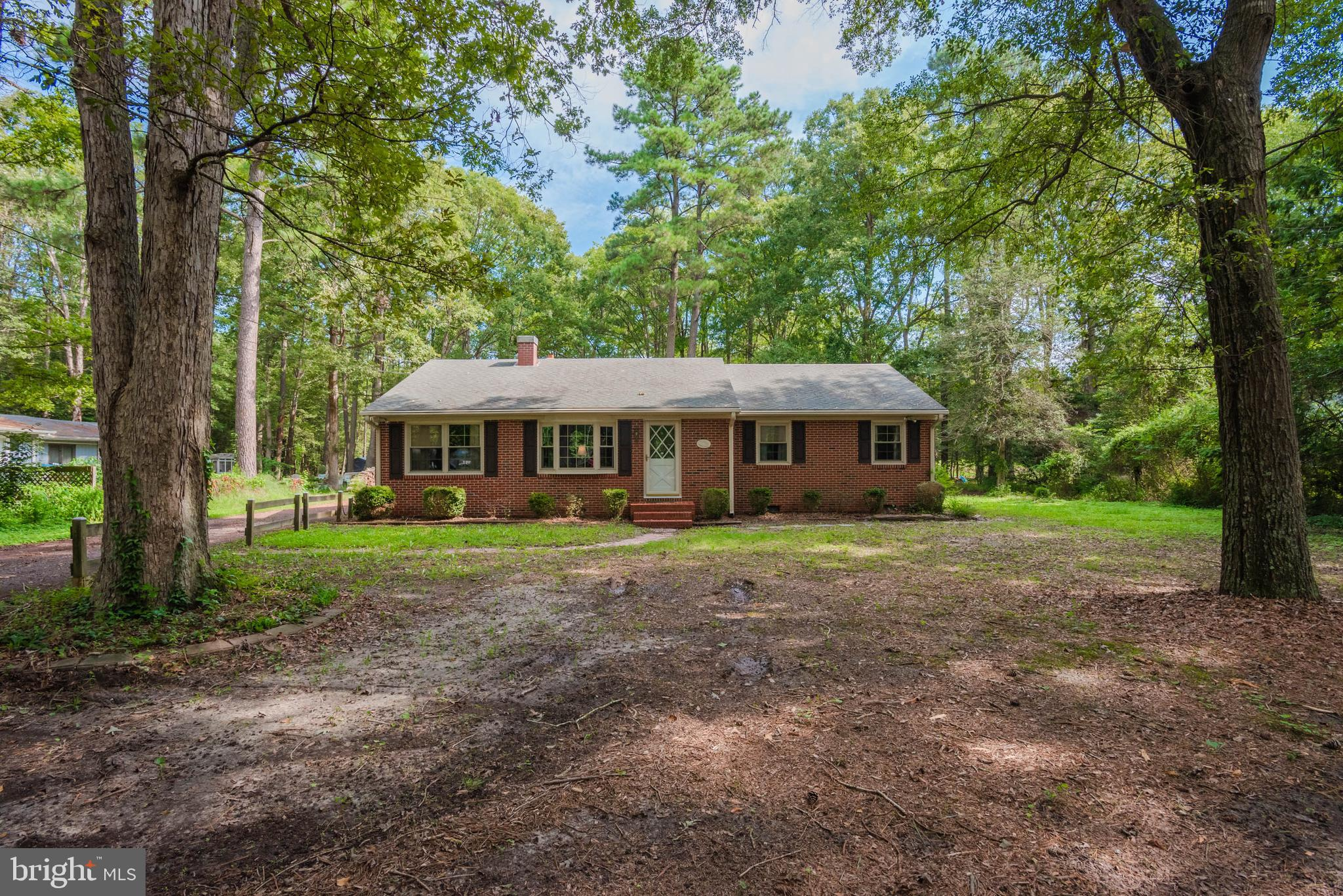 Close to town but not in the fray. This solid brick rancher is situated on 1 acre lot just east of N