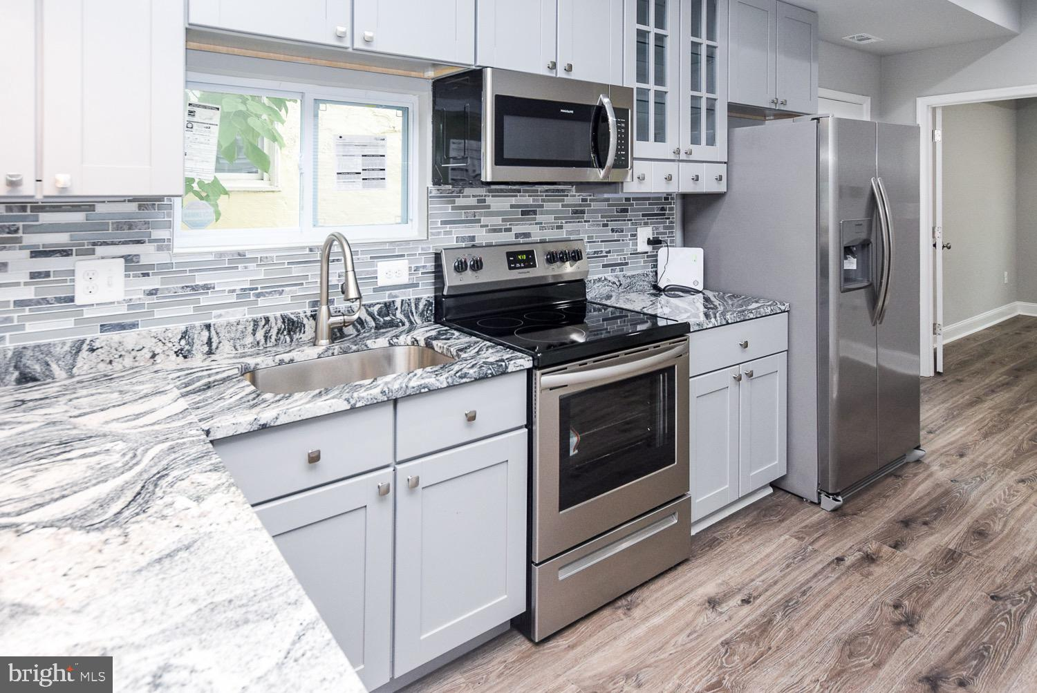 Brand New Renovation -Amazing Open Floor Plan -4 Bedrooms and 3 Full Bathrooms. Fully Renovated with