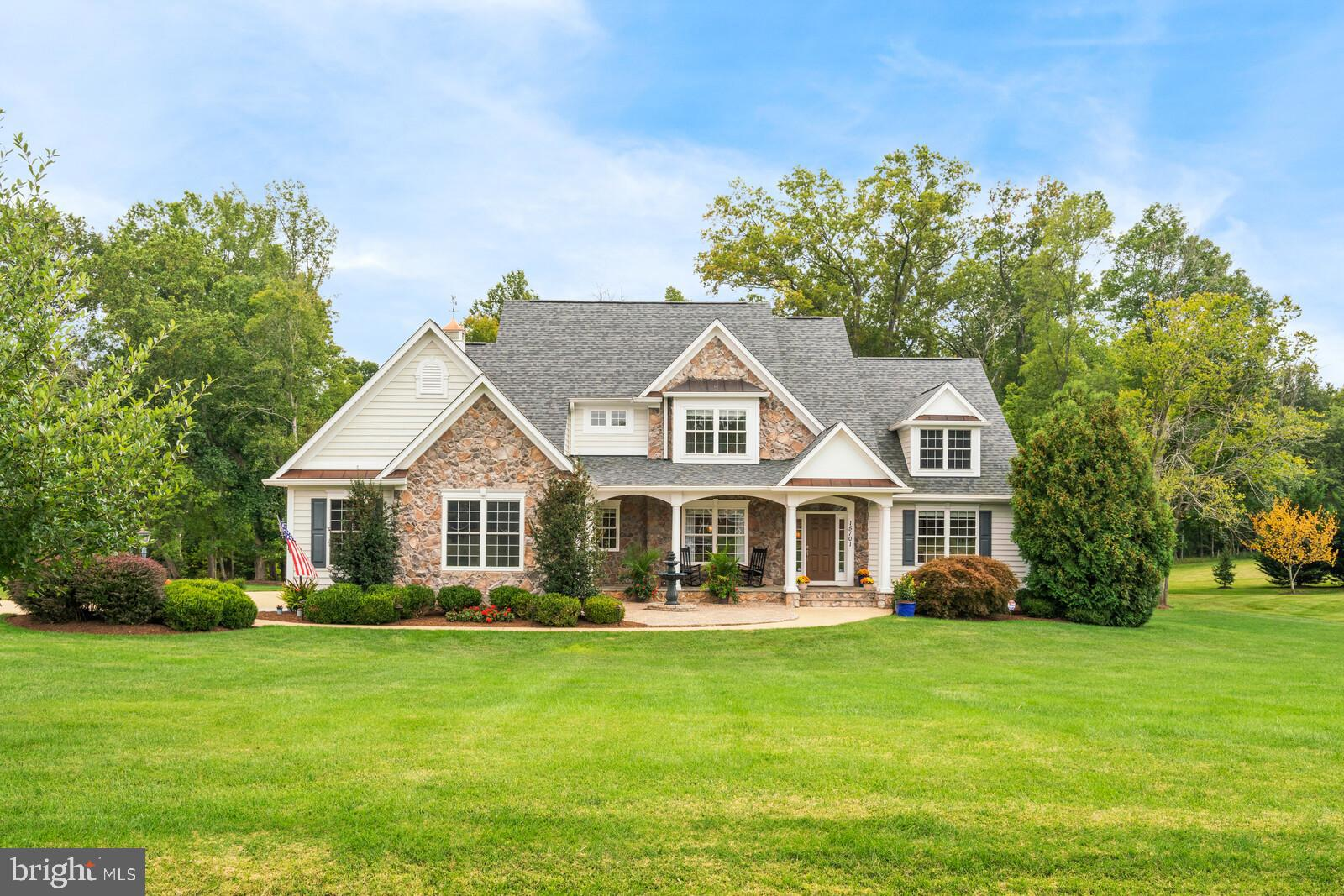 Gorgeous custom home on 2 acres in Evergreen Farm with Stone and vinyl siding exterior. Enter this h