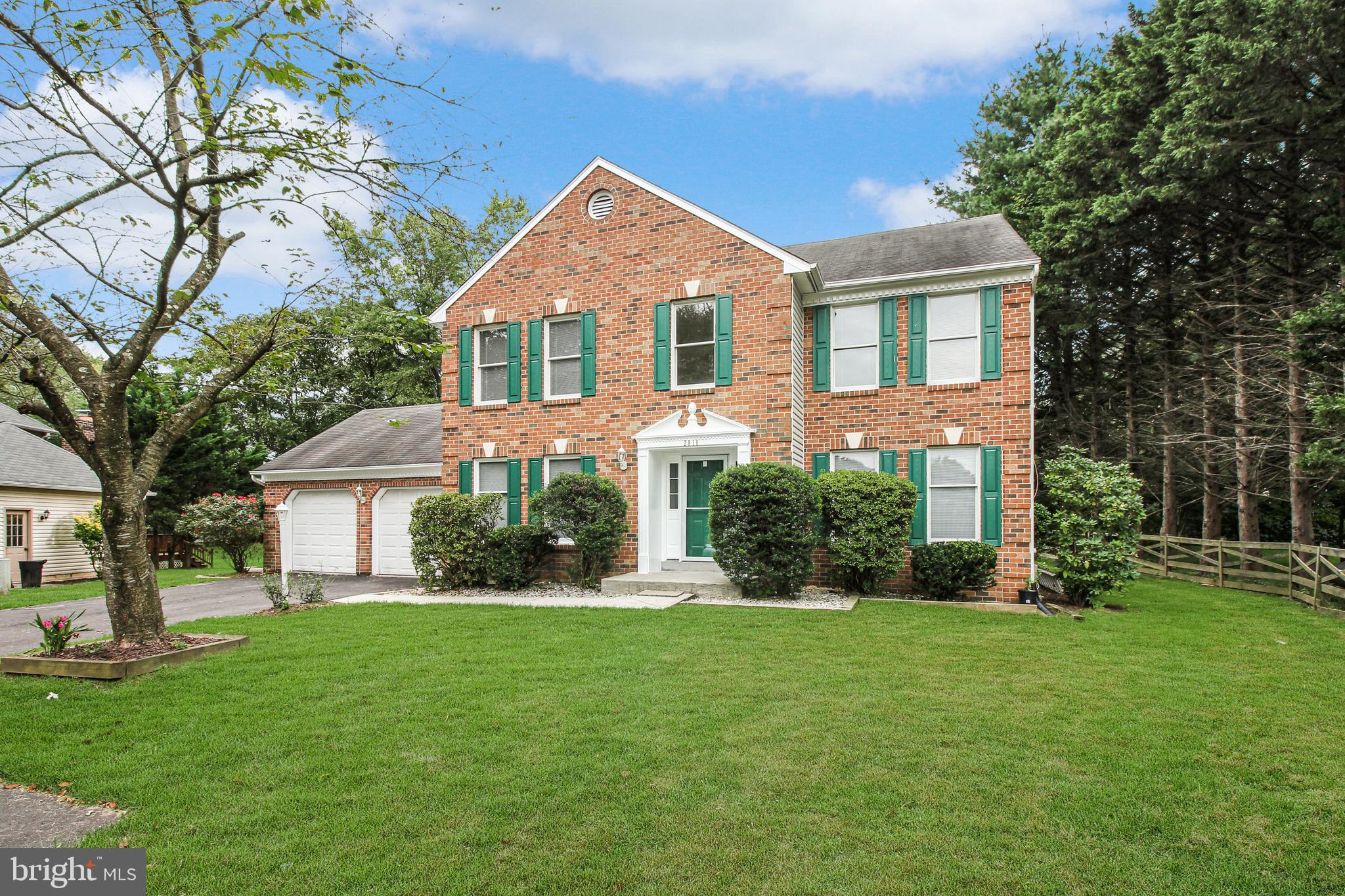 Immerse in the comfort and beauty of your new home!!! This beautiful brick front Colonial on 1/2 acr