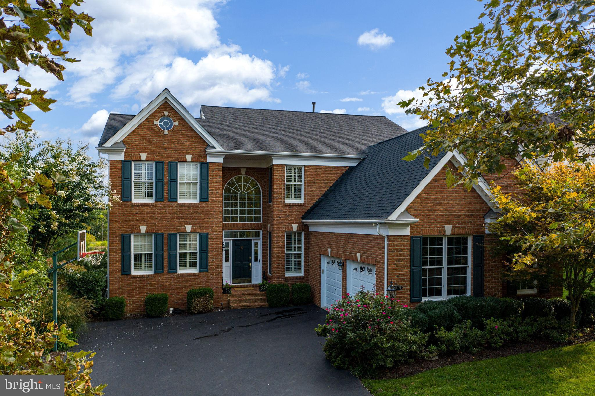 Gorgeously situated on lush 12th green of Dominion Valley Country Club**Majestic views of golf cours