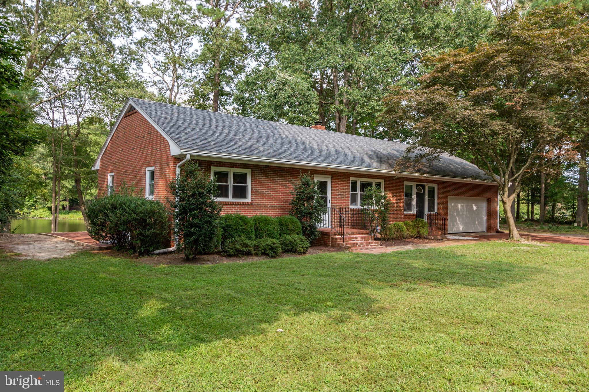 Your Waterfront, Brick Home Awaits! Start your Day Overlooking Leonards Mill Pond with Dock! The Sce