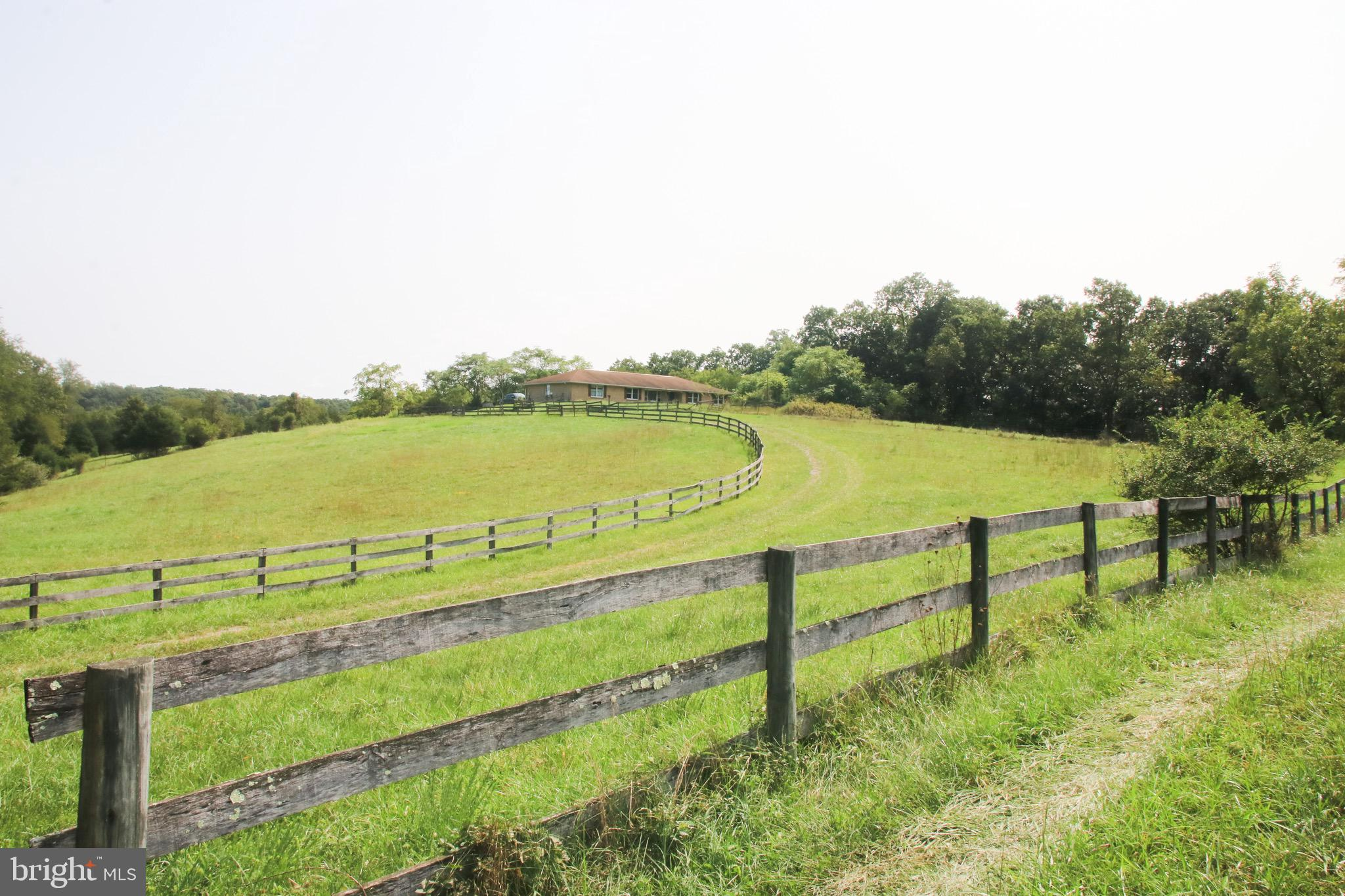 Fabulous all brick rancher with 5 unrestricted acres and complete privacy.  A total diamond in the r