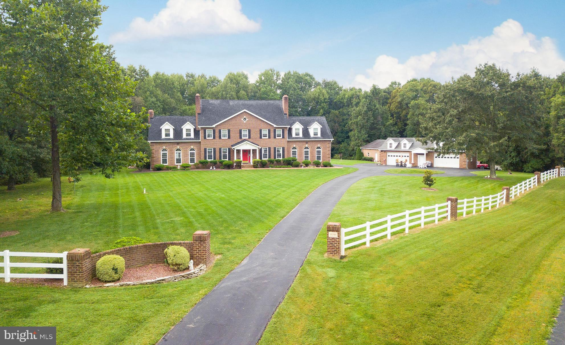You have to see this one yourself!!! All brick colonial situated on over 23 acres! Spacious inside w
