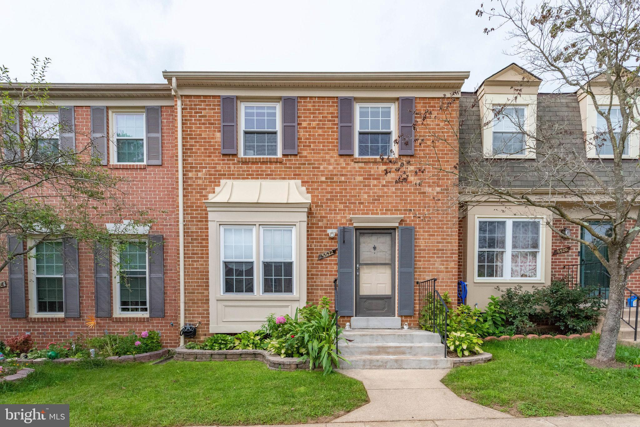 A must see!  This home has been extensively upgraded.   A brick front townhome with  all the desirab