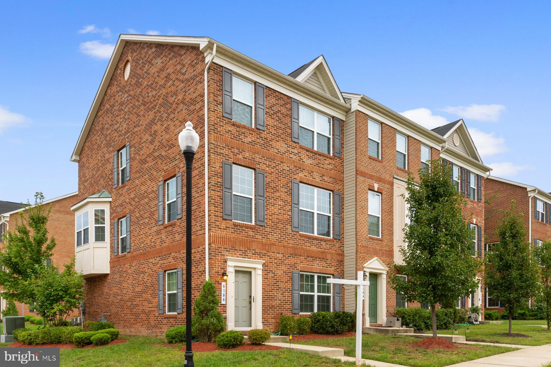 Welcome home to this impeccable 3-level end unit townhouse with 2 sided brick in Indian Head.  2- ca
