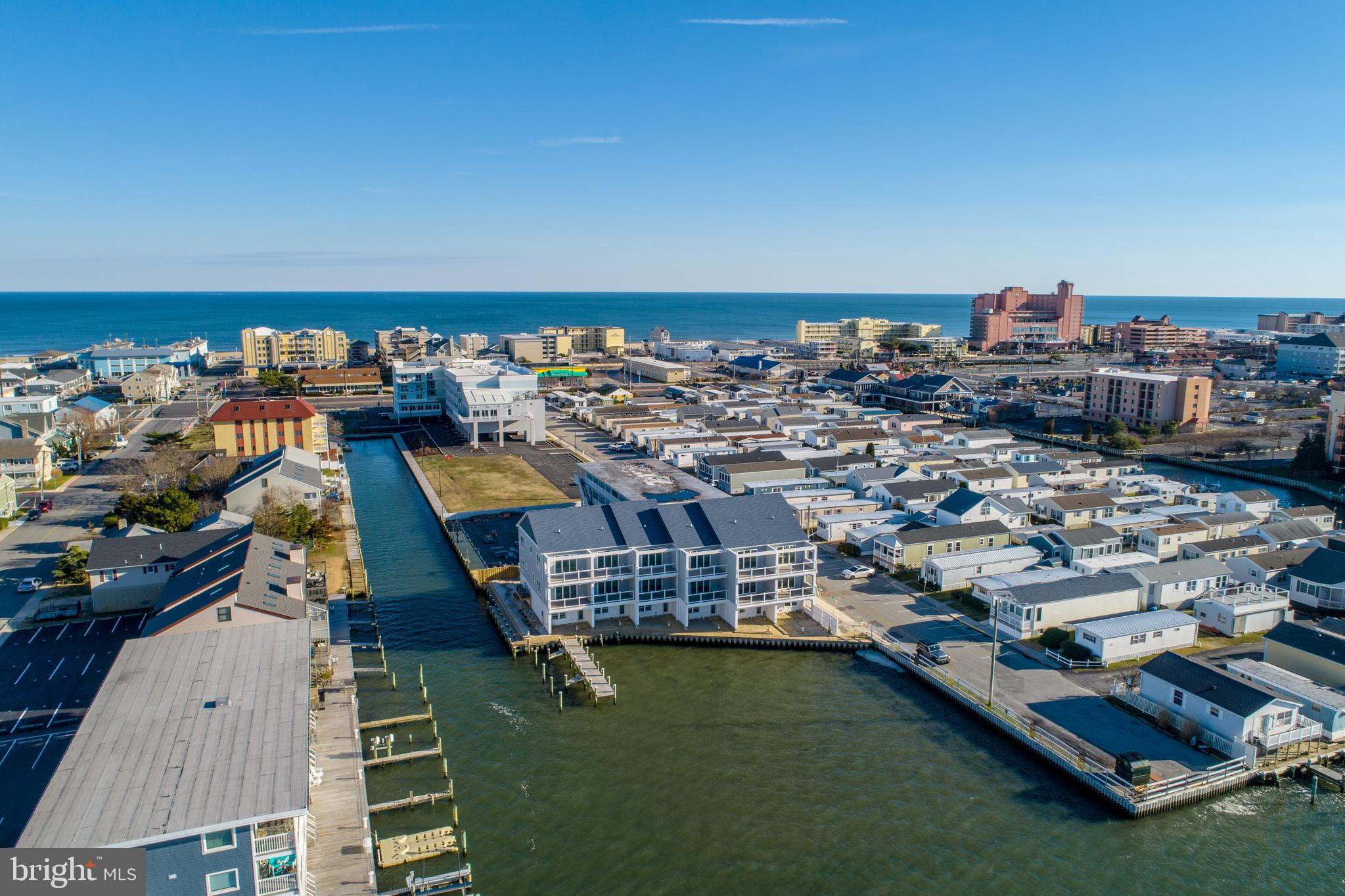 Absolutely Stunning brand new construction on DIRECT BAYFRONT with over 200' of waterfrontage with new 50yr Vinyl Bulkhead.  One of the last locations with views and water access left in Ocean City.  Excellent Construction by long-time local builder with high end finishes - Hardwood  and Custom Tile floors and Architectural Doors throughout plus Gas Rannai Tankless Water Heater.  Kitchen has quartz counters, glass tile backsplash, stainless steel appliances and upgraded fixtures with large pantry.  Living Room offers stunning direct bayfront views with huge balcony.  Bayfront Master Suite with private balcony, gorgeous tile walk-in shower, double sink and dual closets. Huge 2+ Car Garage with large beach/boat storage plus custom built-in entry bench.  Boat Slip with 100' of additional bulkhead for jet skis, kayaking, and guests.    Taxes and Fees are Estimated.